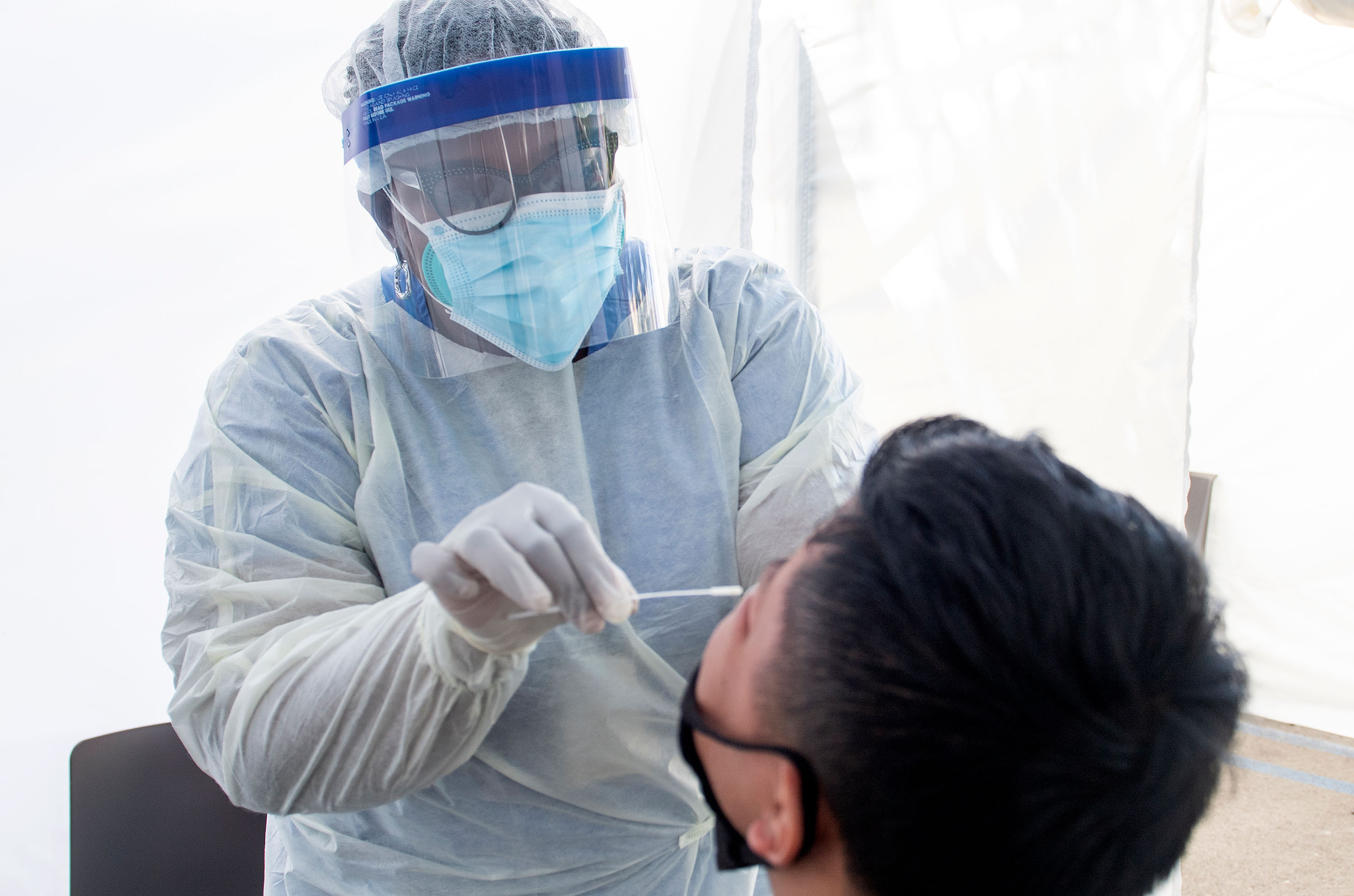 A health worker takes a nasal swab sample at a Covid-19 testing site on July 24 in Los Angeles, California.