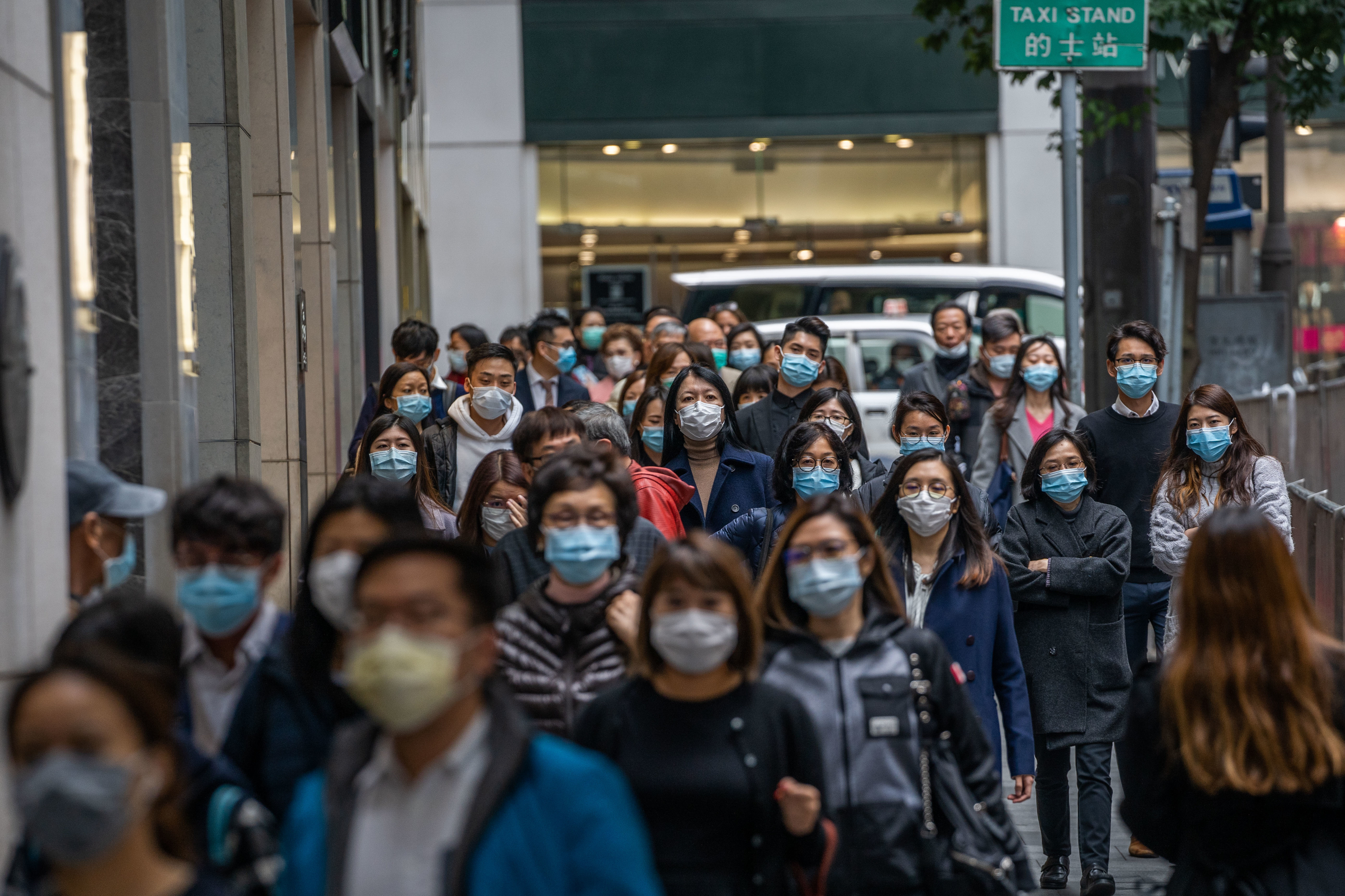 People wearing surgical masks in central district of Hong Kong as a preventative measure following the Coronavirus outbreak which began in the Chinese city of Wuhan.