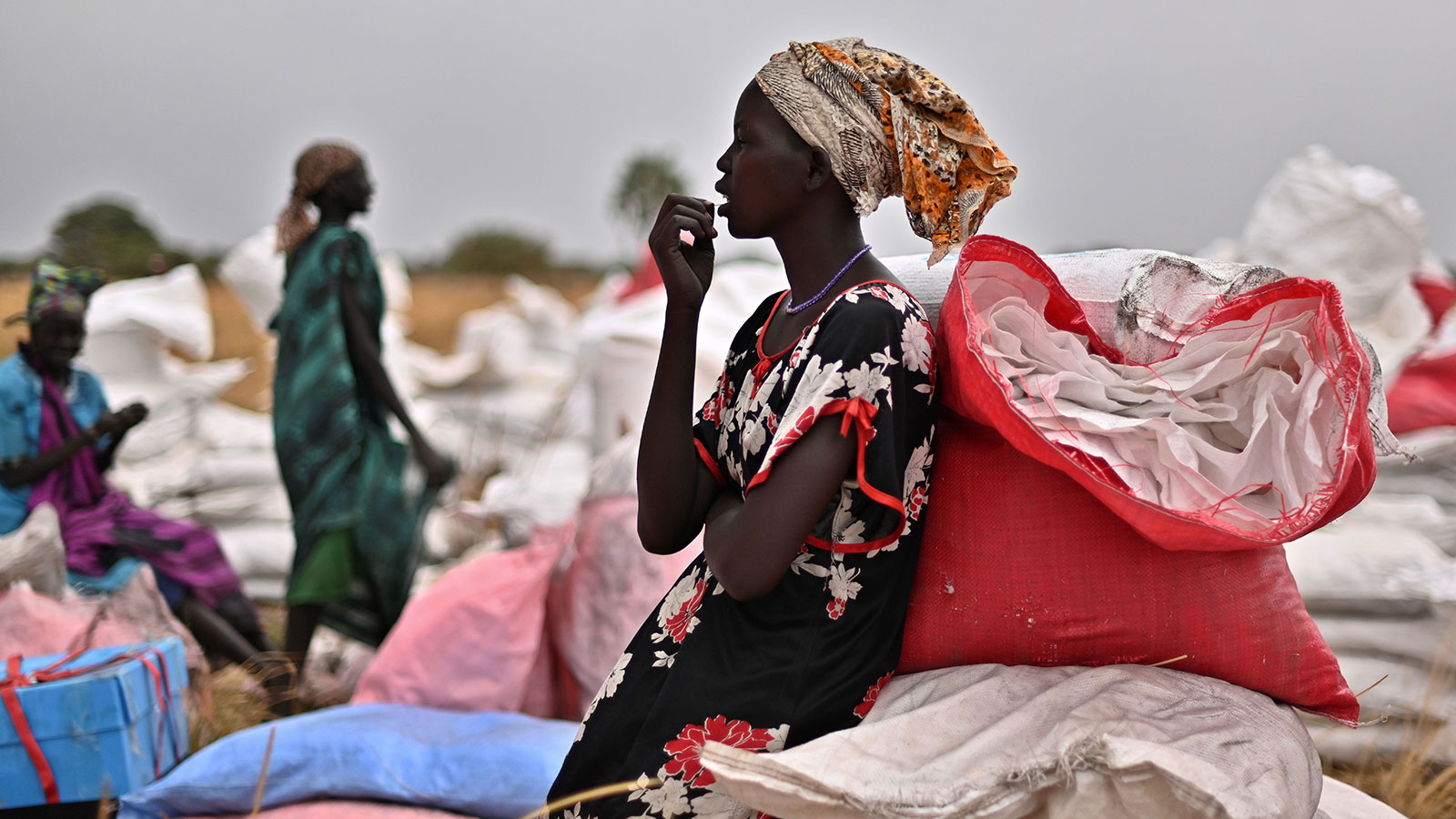 A villager who had volunteered to fetch bags containing food rations from the site of an air drop takes a break at a village in Ayod county in South Sudan on February 6.