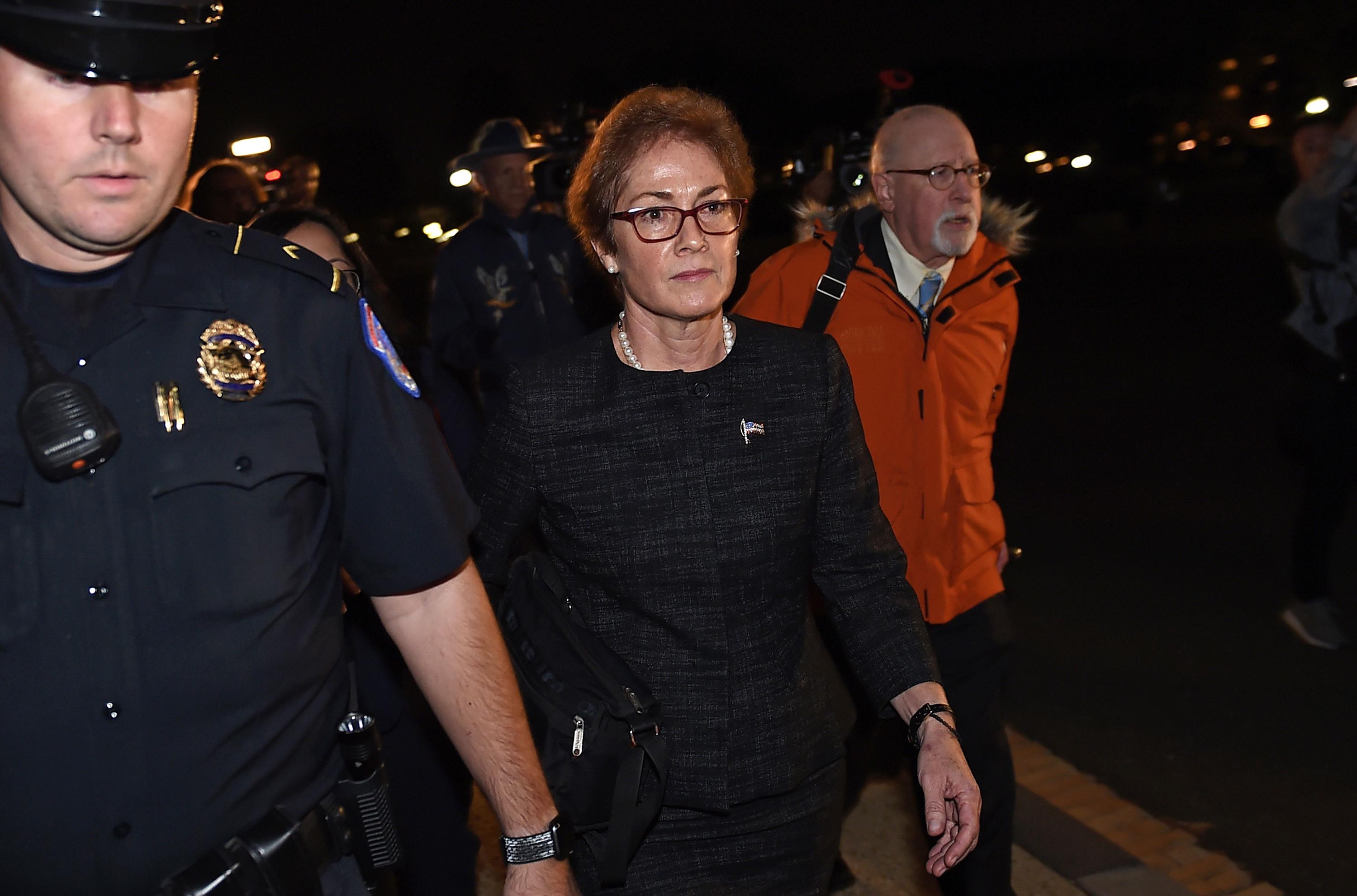 Marie Yovanovitch (center) flanked by lawyers, aides and Capitol police, leaves the US Capitol, October 11, after testifying behind closed doors.