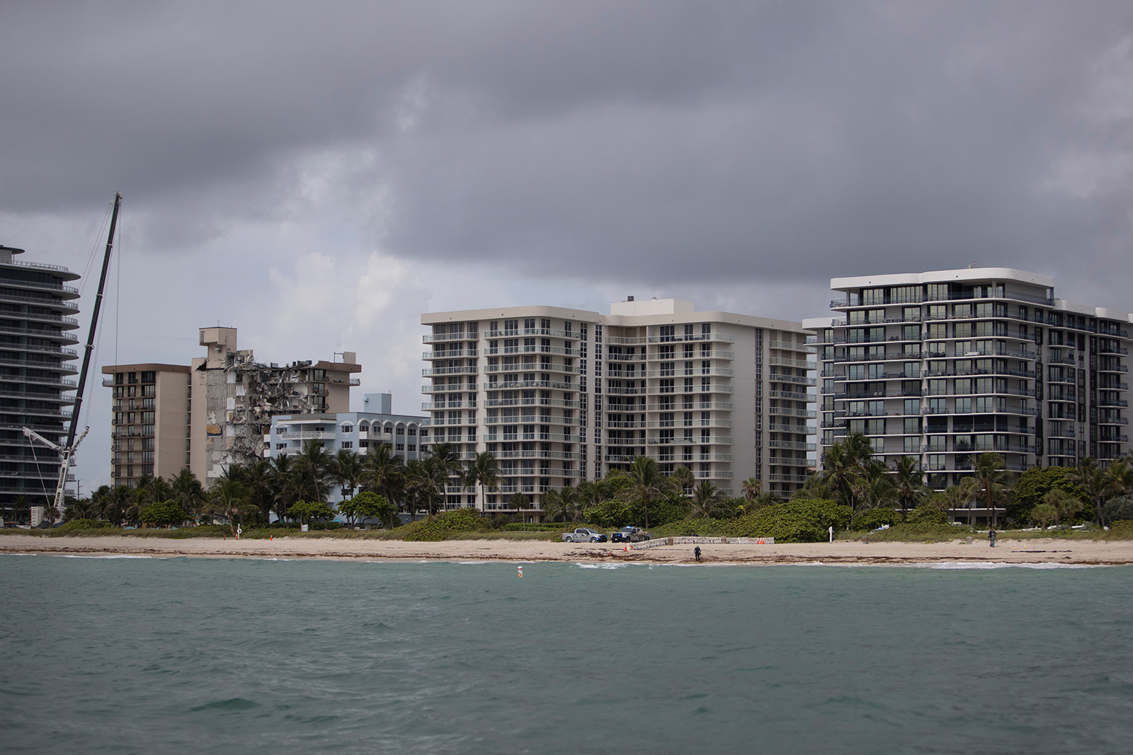 The Champlain Towers North (far right) stands near its sister building, the partially collapsed 12-story Champlain Towers South condo building, on June 29 in Surfside, Florida.
