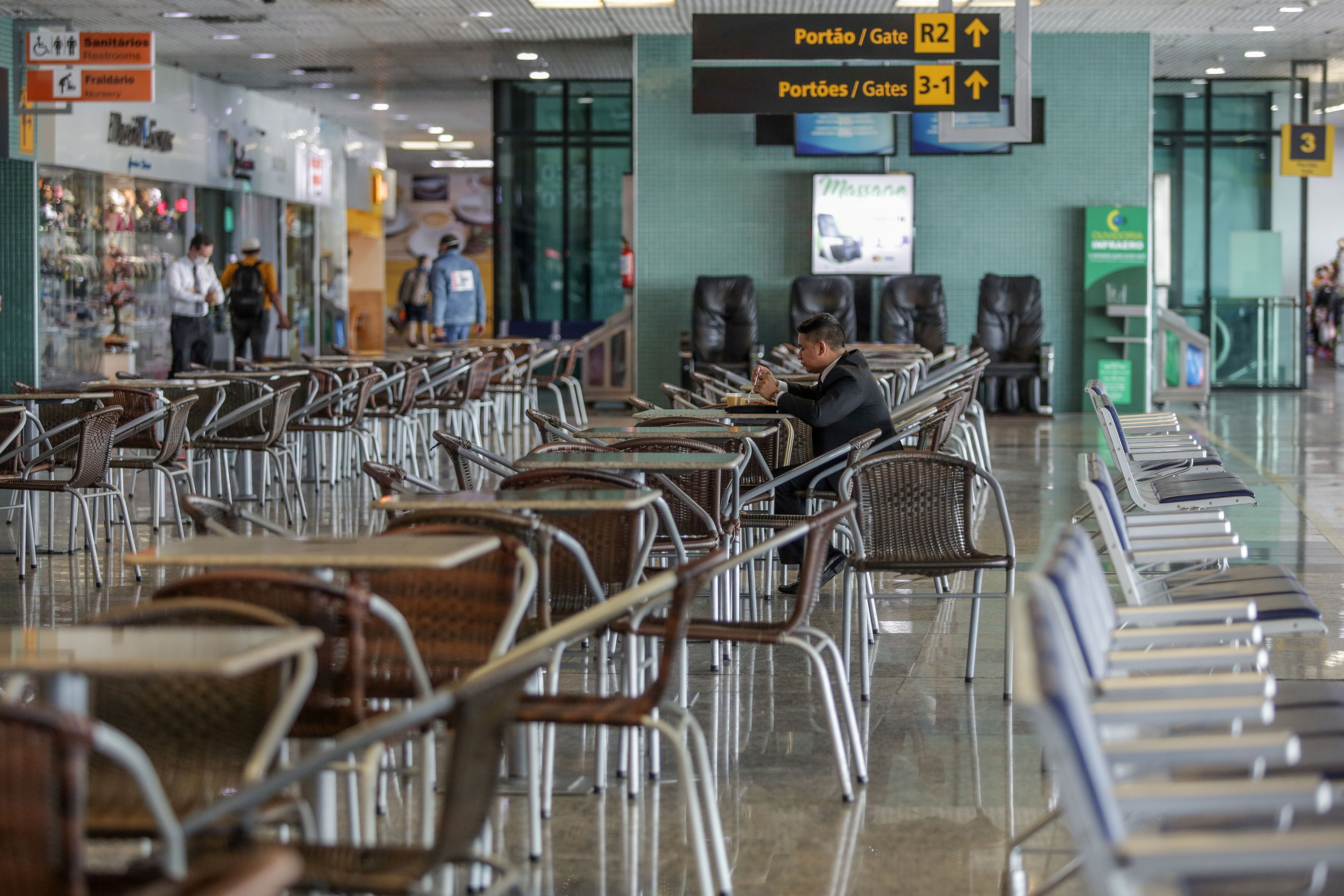 A man sits alone at the food court ofthe Manaus AM Eduardo Gomes International Airport in Manaus, Brazil, on May 18.
