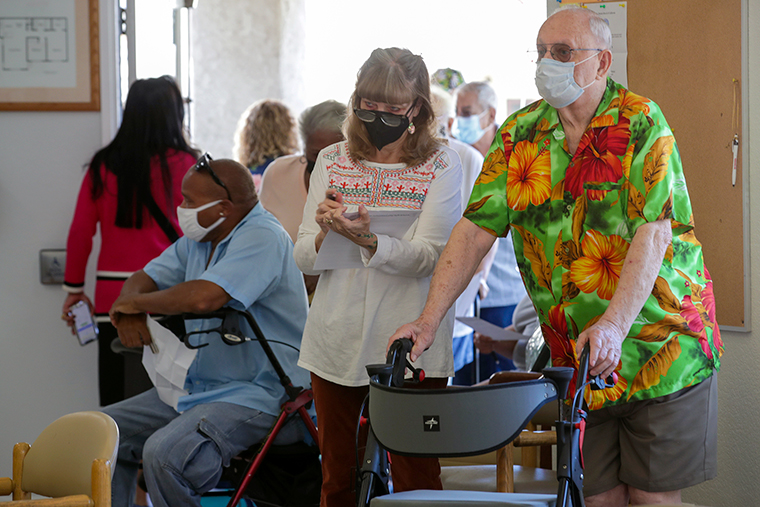Jack Orre, 89, and his daughter Linda Davis, 60, wait in line for coronavirus vaccine at a COVID-19 vaccine clinic held by L.A. County Department of Public Health for seniors at Whispering Fountains Senior Living Community on Wednesday, March 31, in Lakewood, CA.