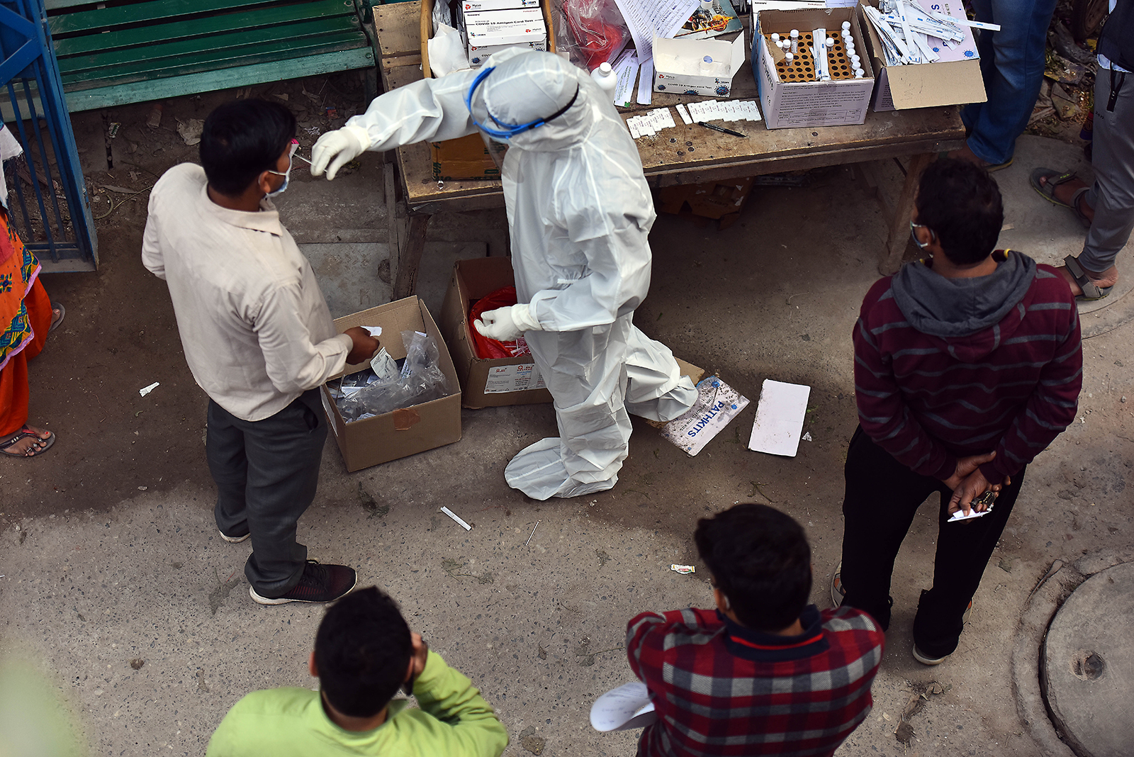 A health worker collects a swab sample from a man for Covid-19 test, at a dispensary in New Delhi, India, on December 5.