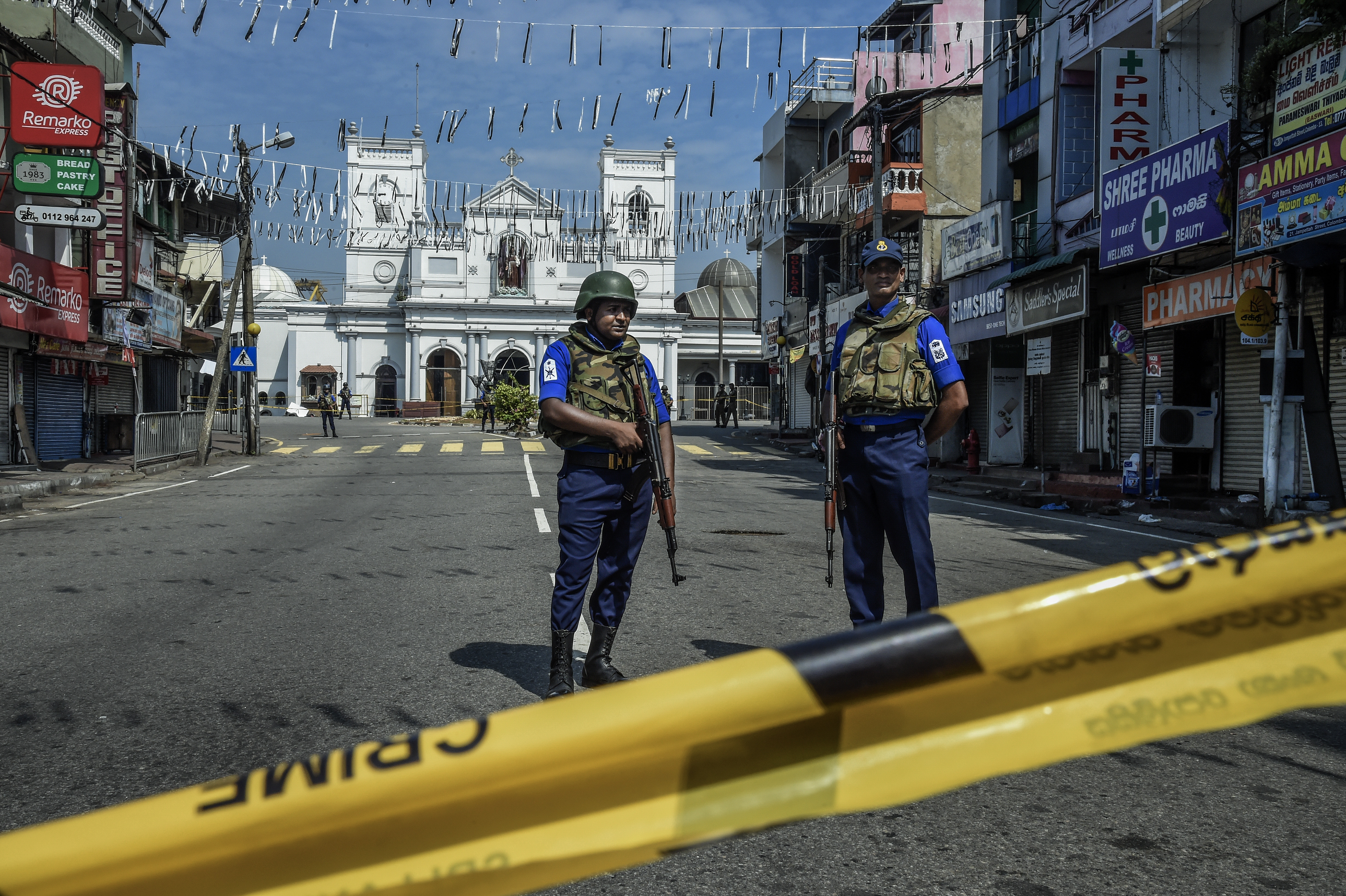 Security personnel stand guard at St Anthony's Church on April 24, 2019 in Colombo, Sri Lanka.