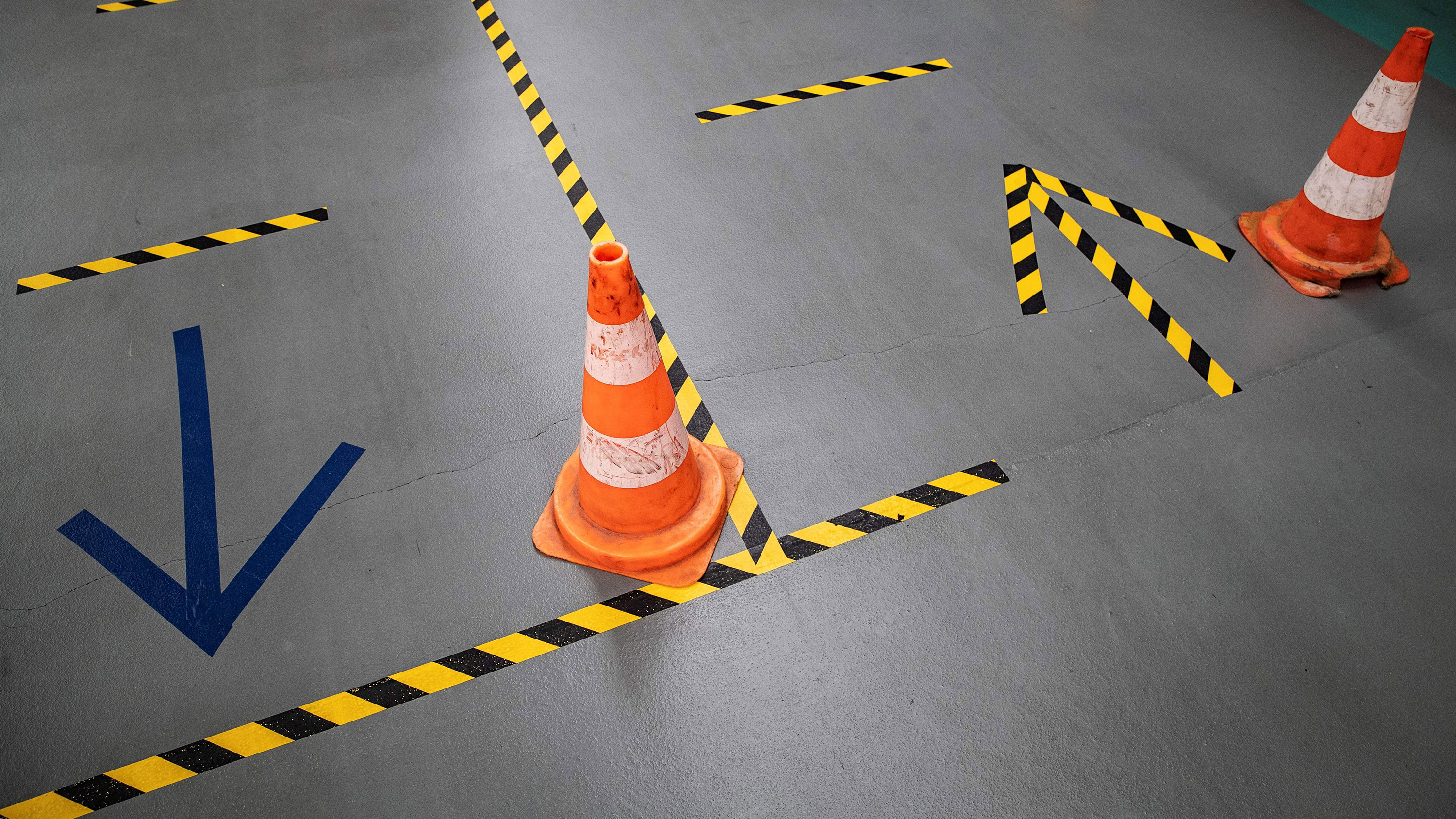 Cones and tape on the ground help employees of French automaker PSA Peugeot-Citroen to keep social distances required at the Poissy, France, plant on April 15.