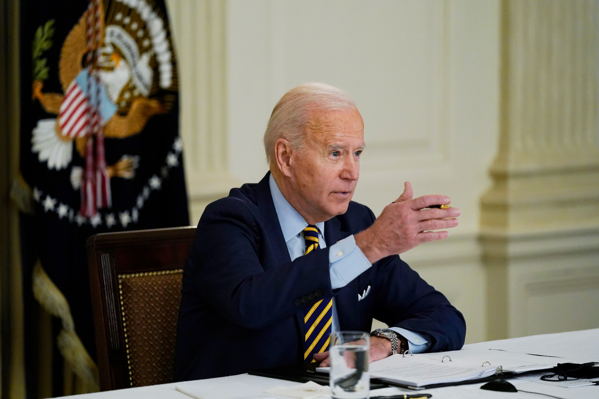 President Joe Biden speaks during a virtual meeting from the State Dining Room of the White House on March 12 in Washington, DC.