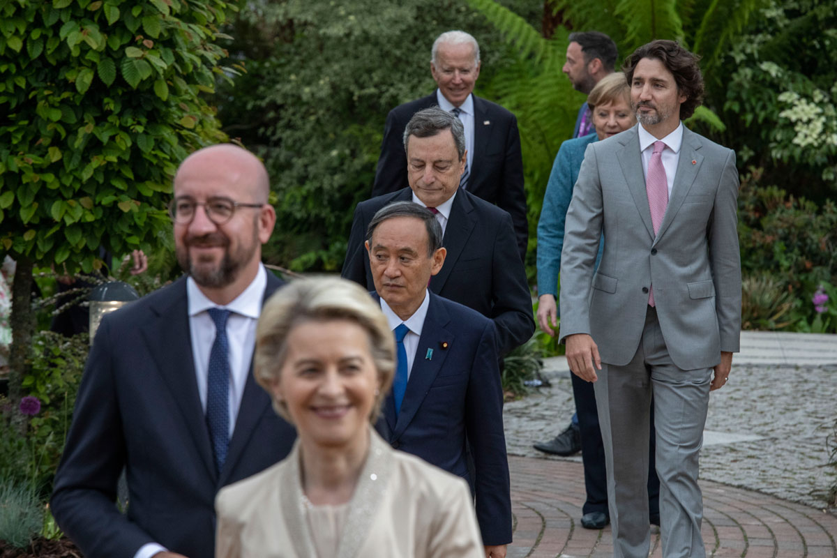 President of the European Commission Ursula von der Leyen, President of the European Council Charles Michel, Japanese Prime Minister Yoshihide Suga, Italian Prime Minister Mario Draghi, Canadian Prime Minister Justin Trudeau, German Chancellor Angela Merkel and United States President Joe Biden arrive for a drinks reception at The Eden Project during the G7 Summit on Friday in St Austell, Cornwall, England.