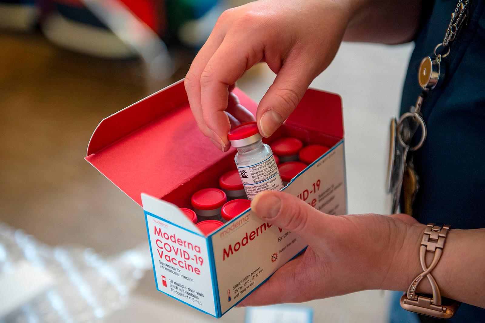 Courtney Senechal unpacks Moderna Covid-19 vaccines for use at the East Boston Neighborhood Health Center in Boston, Massachusetts on December 24, 2020.