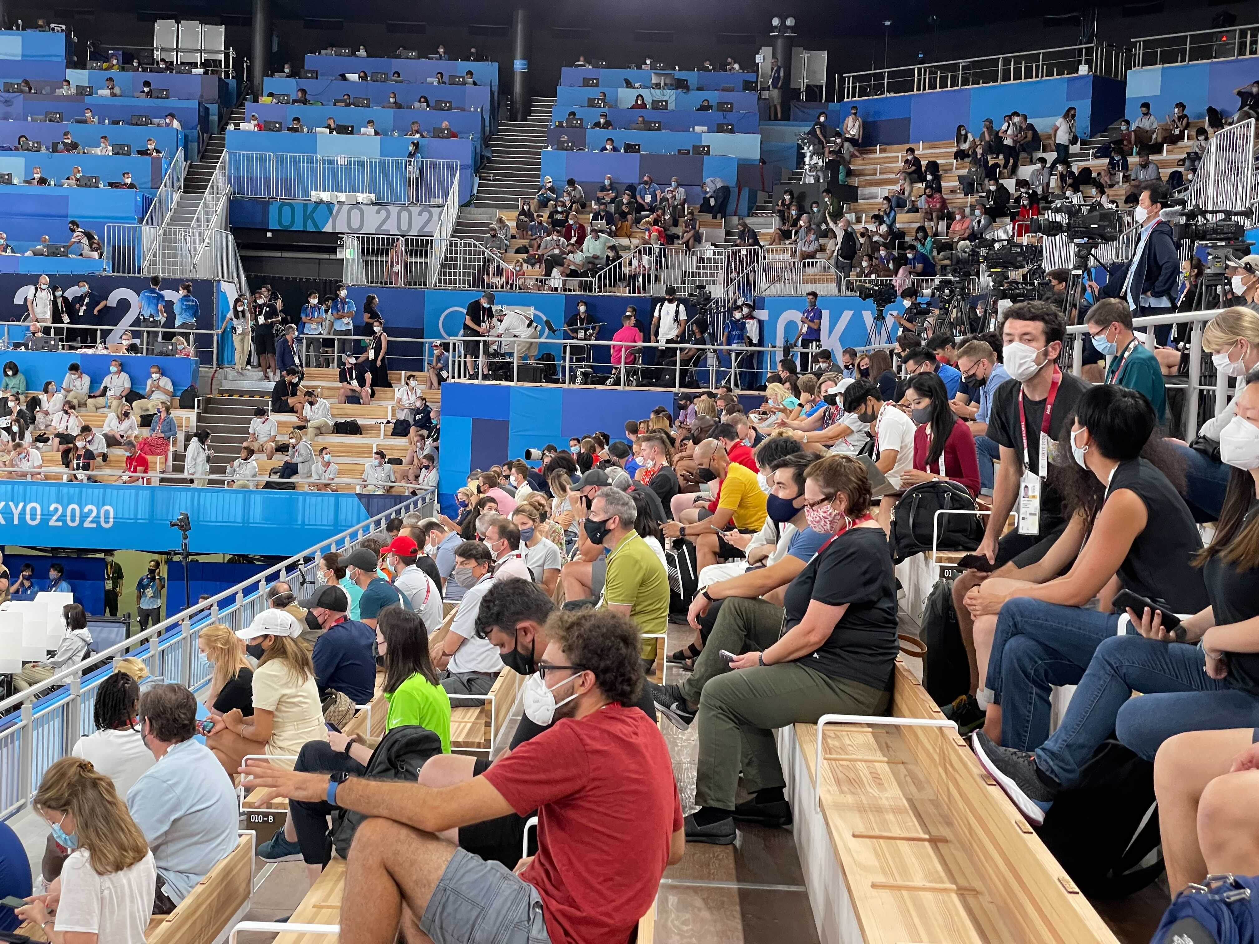 Members of the media are seen in the stands ahead of the women's balance beam final event.