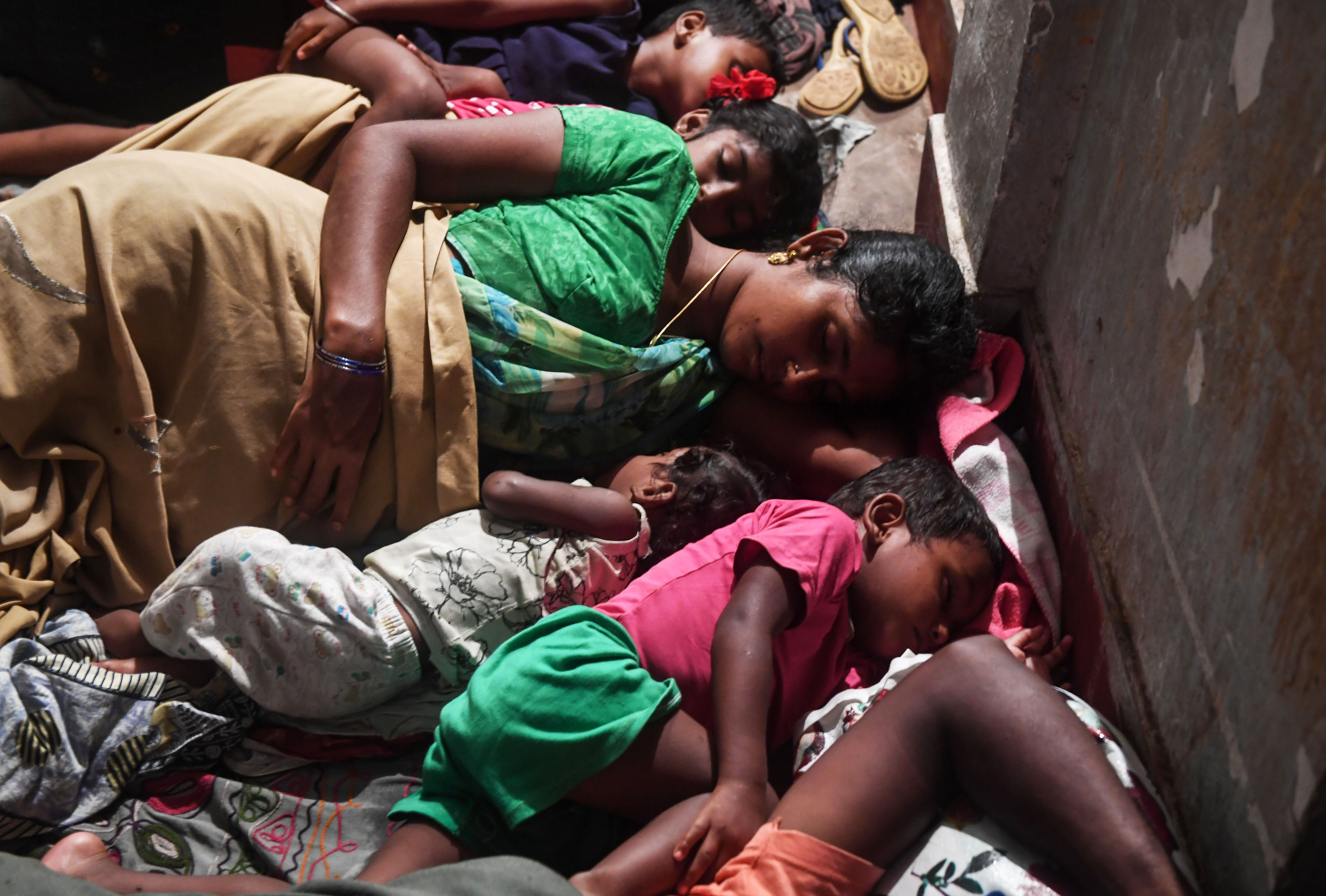 Evacuees in a relief shelter in Puri, in the eastern Indian state of Odisha, on Friday.