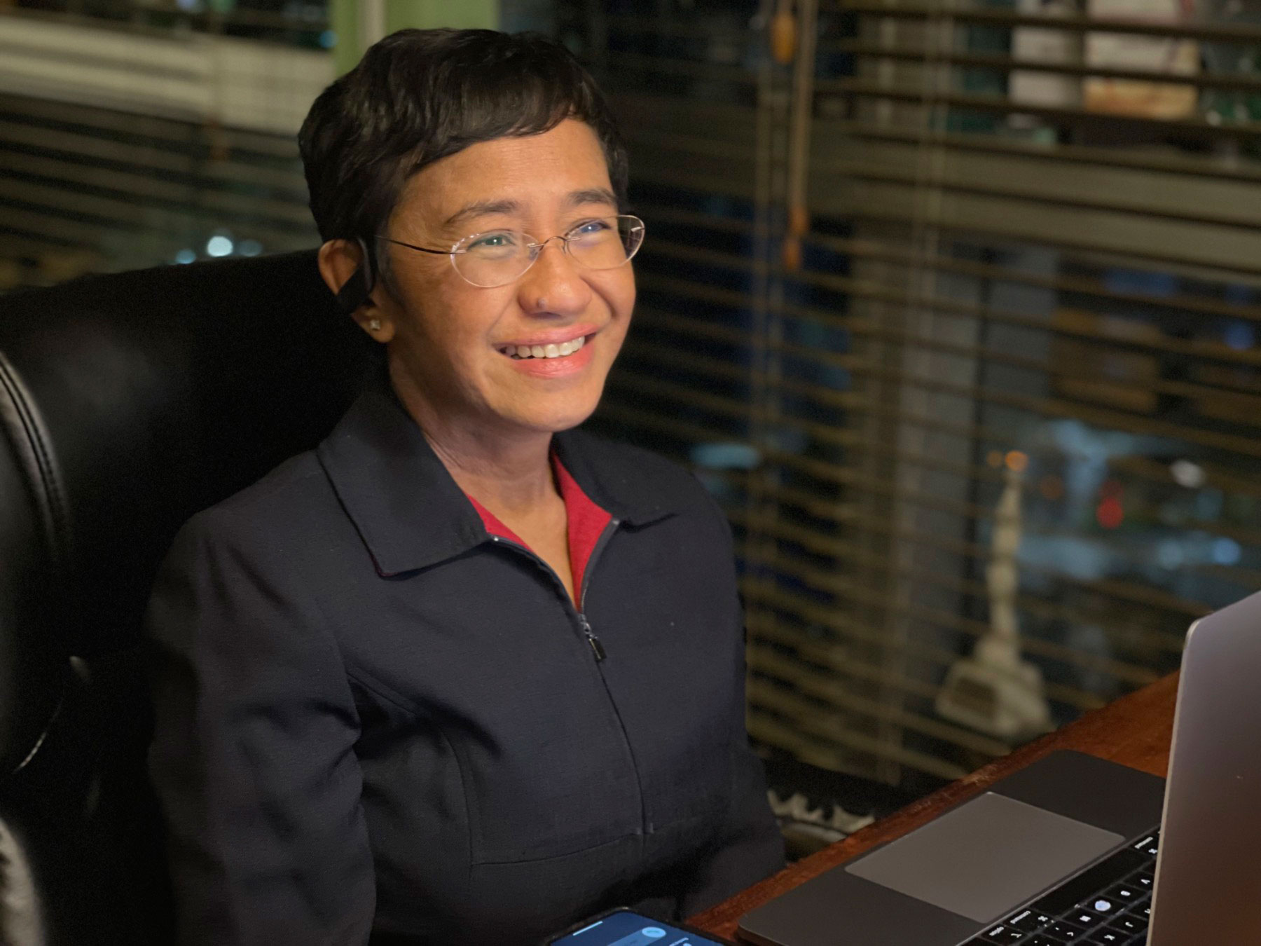 In this photo provided by Rappler, CEO and Executive Editor Maria Ressa reacts after hearing of her winning the Nobel Peace Prize inside her home in Metro Manila, Philippines on October 8, 2021.