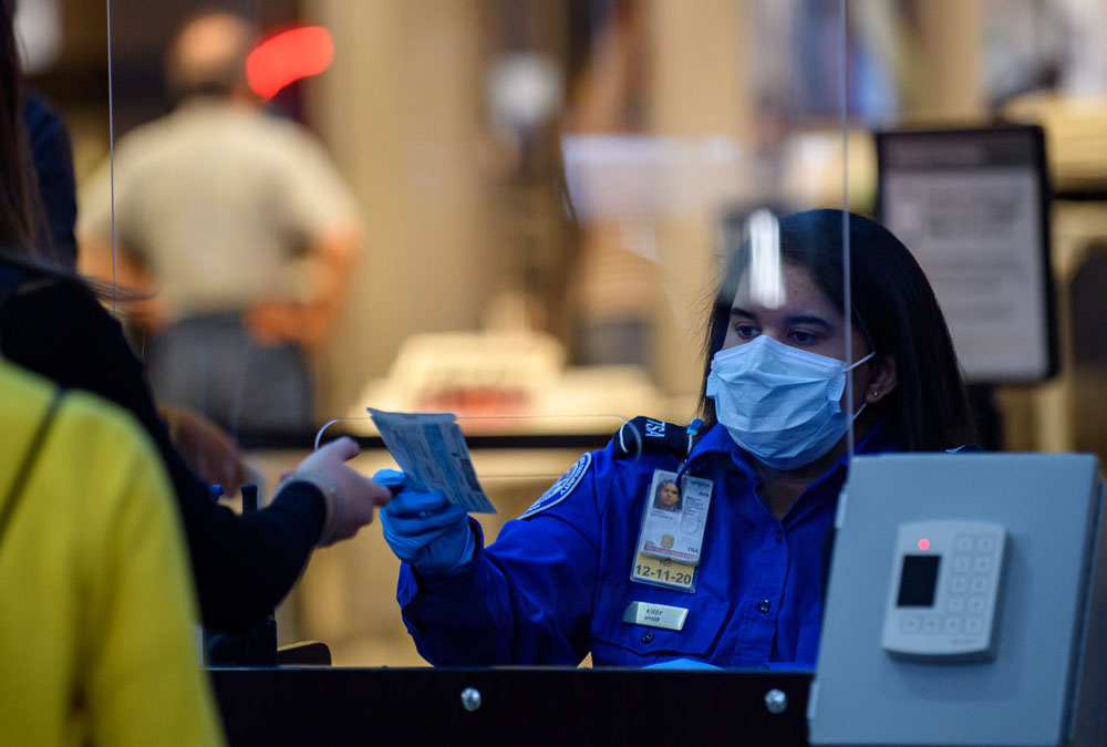 Travelers make their way through ticketing and TSA inspection as State of Pennsylvania remains under restrictions for work and travel at Pittsburgh International Airport on May 7, in Pittsburgh, Pennsylvania.