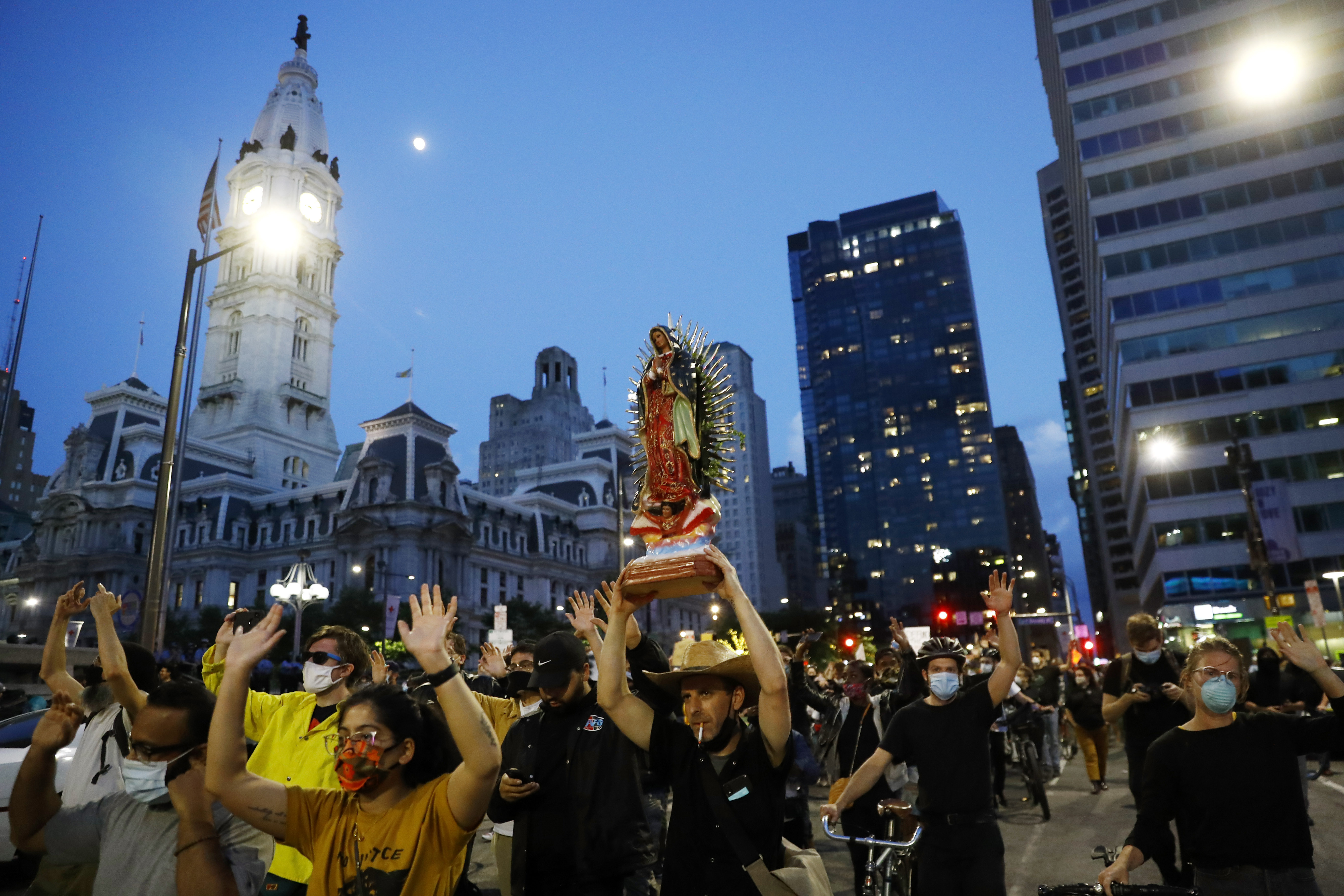 Protesters march past City Hall on June 2 in Philadelphia over the death of George Floyd.