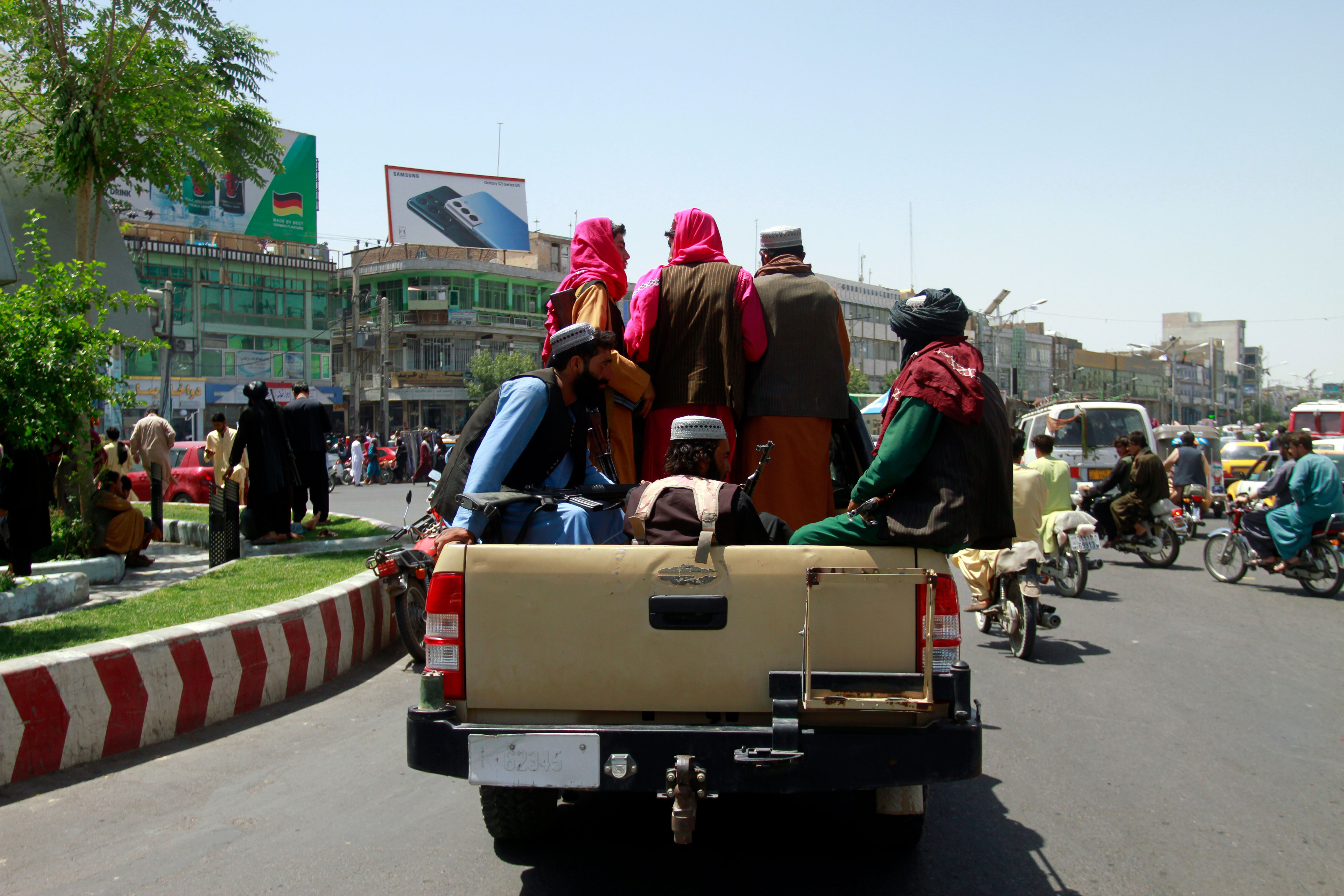 Taliban fighters sit on the back of a vehicle in Herat, Afghanistan, on August 14, 2021.