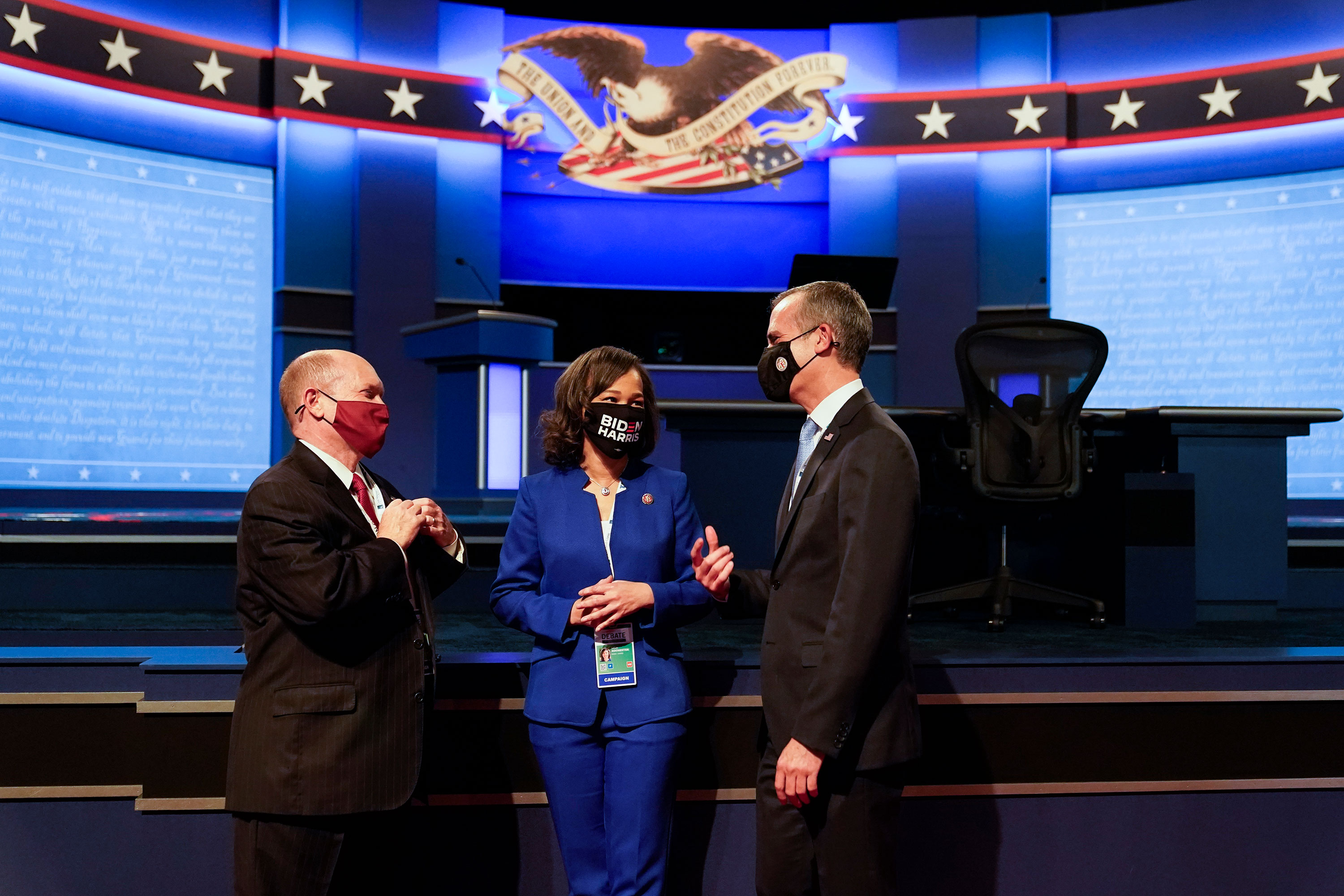 Left to right: Rep. Chris Coons, Rep. Lisa Rochester, and Mayor of Los Angeles Eric Garcetti speak before the start of the first presidential debate on September 29 in Cleveland, Ohio.