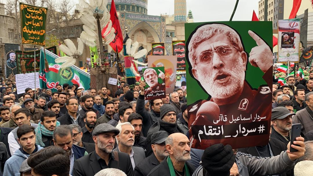 In this photo, protesters hold a poster with a picture of Major General Ismail Qaani, Soleimani's successor, demanding a revenge.