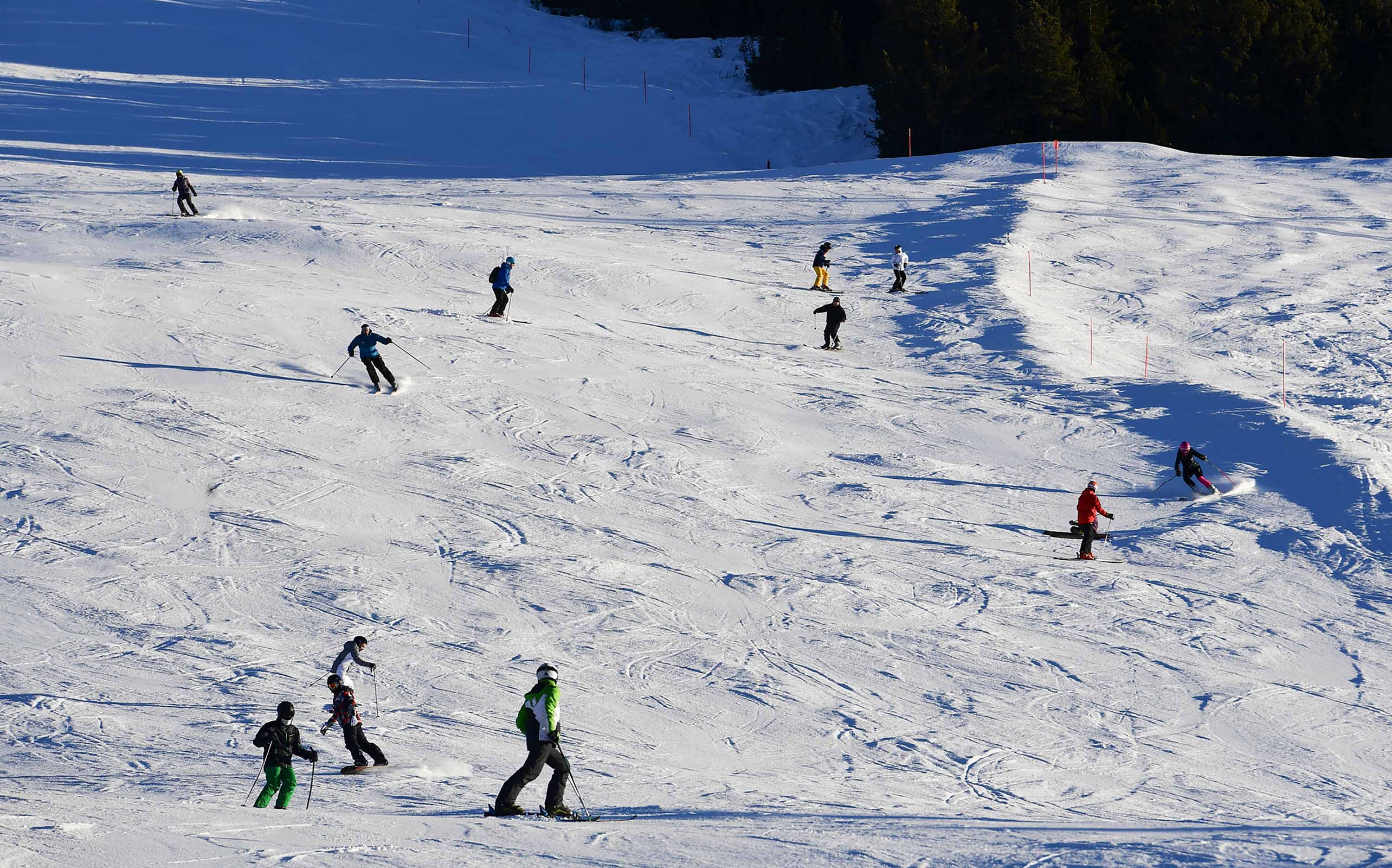 Tourists ski at the Stelvio National Park resort in Bormio, Italy, on December 26, 2018.
