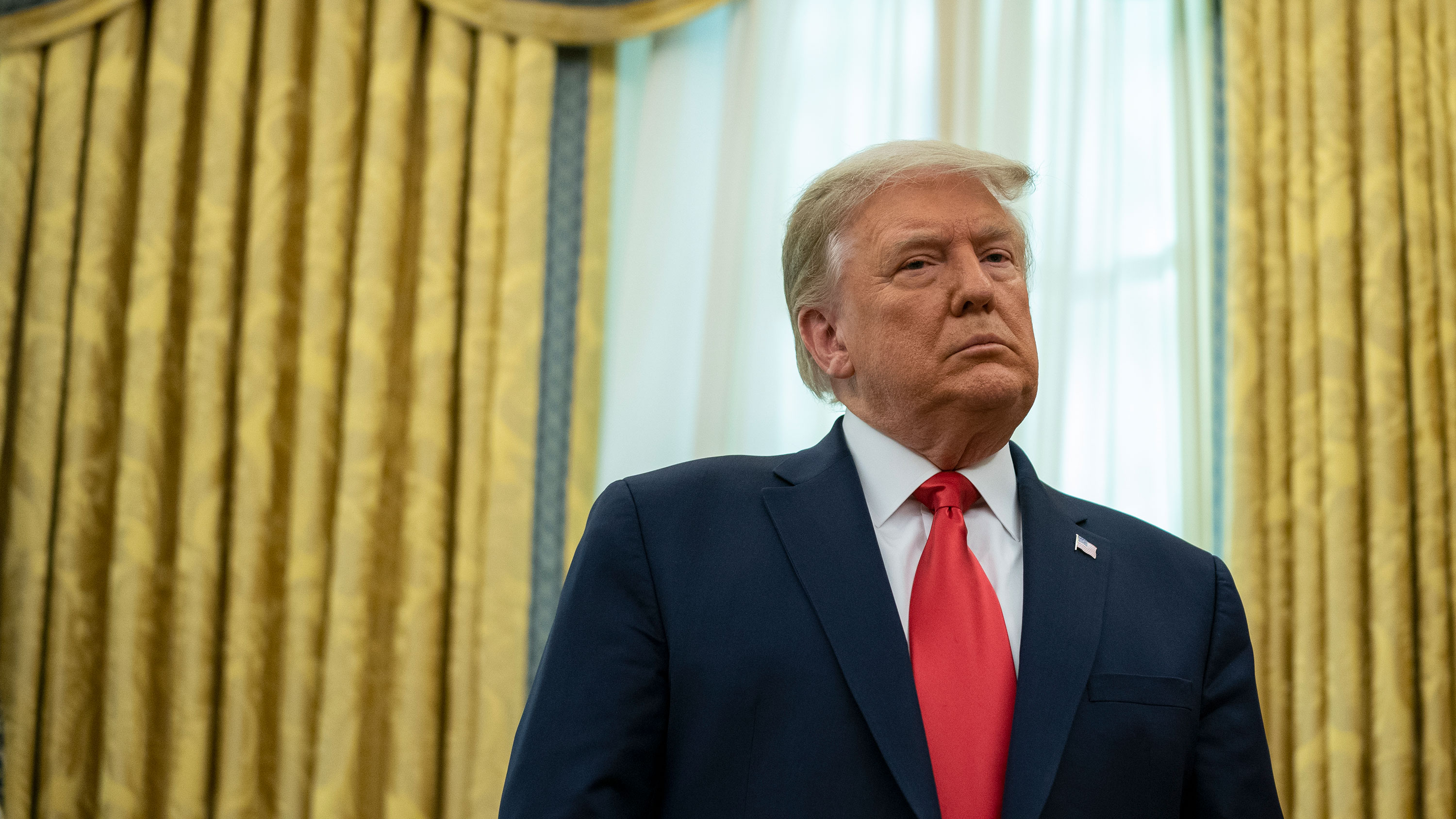 President Donald Trump attends a ceremony in the Oval Office of the White House on December 3 in Washington, DC.