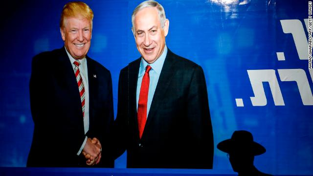 An Ultra-Orthodox Jewish man walks beneath an Israeli election billboard for the Likud Party showing US President Donald Trump shaking hands with Prime Minister Benjamin Netanyahu. (Ahmad Gharabli/AFP/Getty Images)