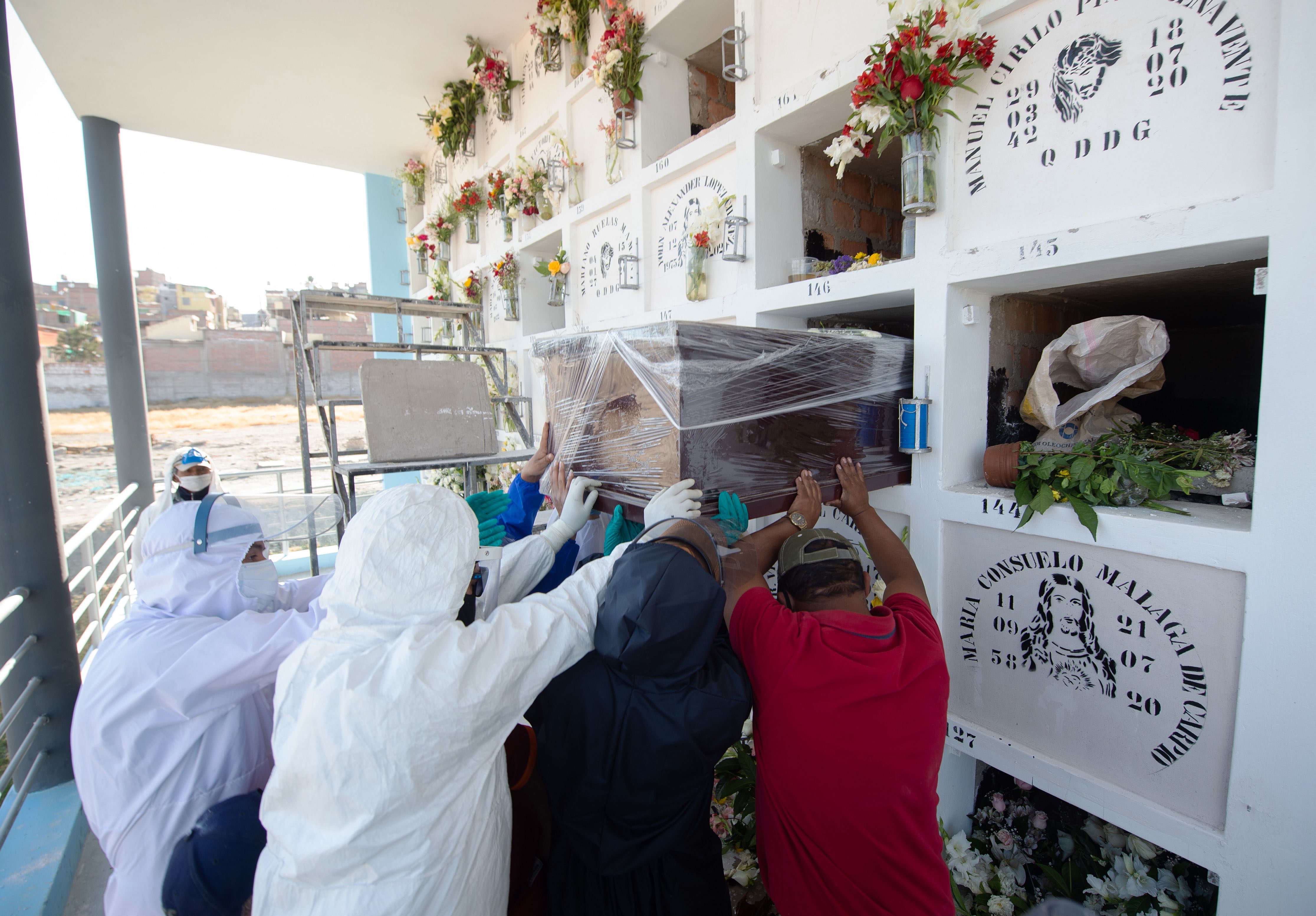 People bury someone said to have died from Covid-19 at a cemetery in Arequipa, Peru, on July 22.