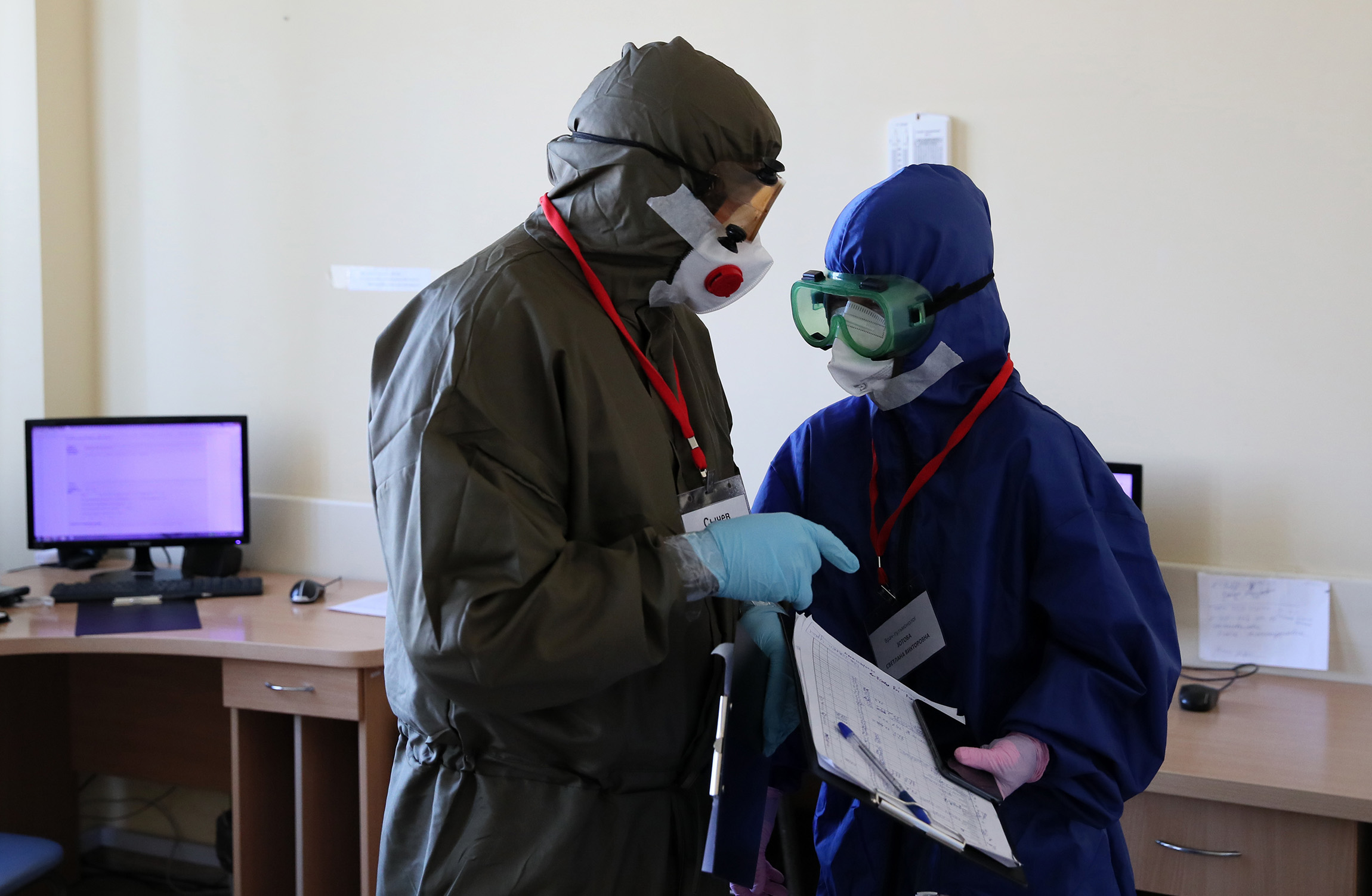 Healthcare providers are seen wearing protective gear in the Krasnodar Territory's Regional Clinical Hospital that offers treatment to COVID-19 patients on Thursday, November 5.