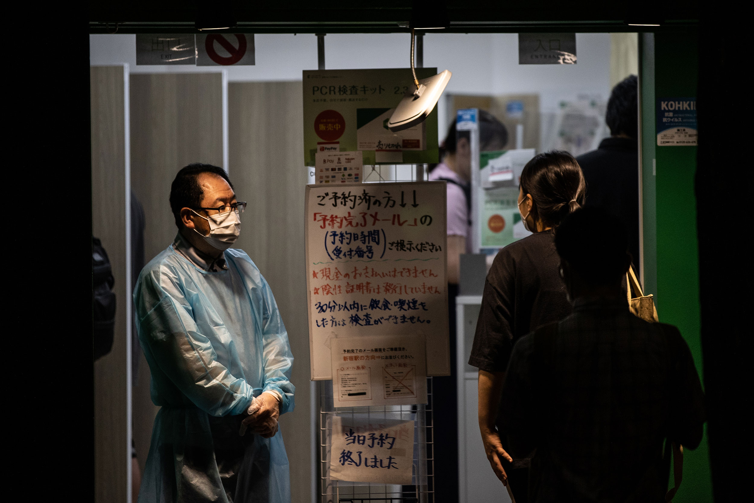 A man wearing personal protective equipment stands in a Covid-19 testing center in Tokyo, on July 14.