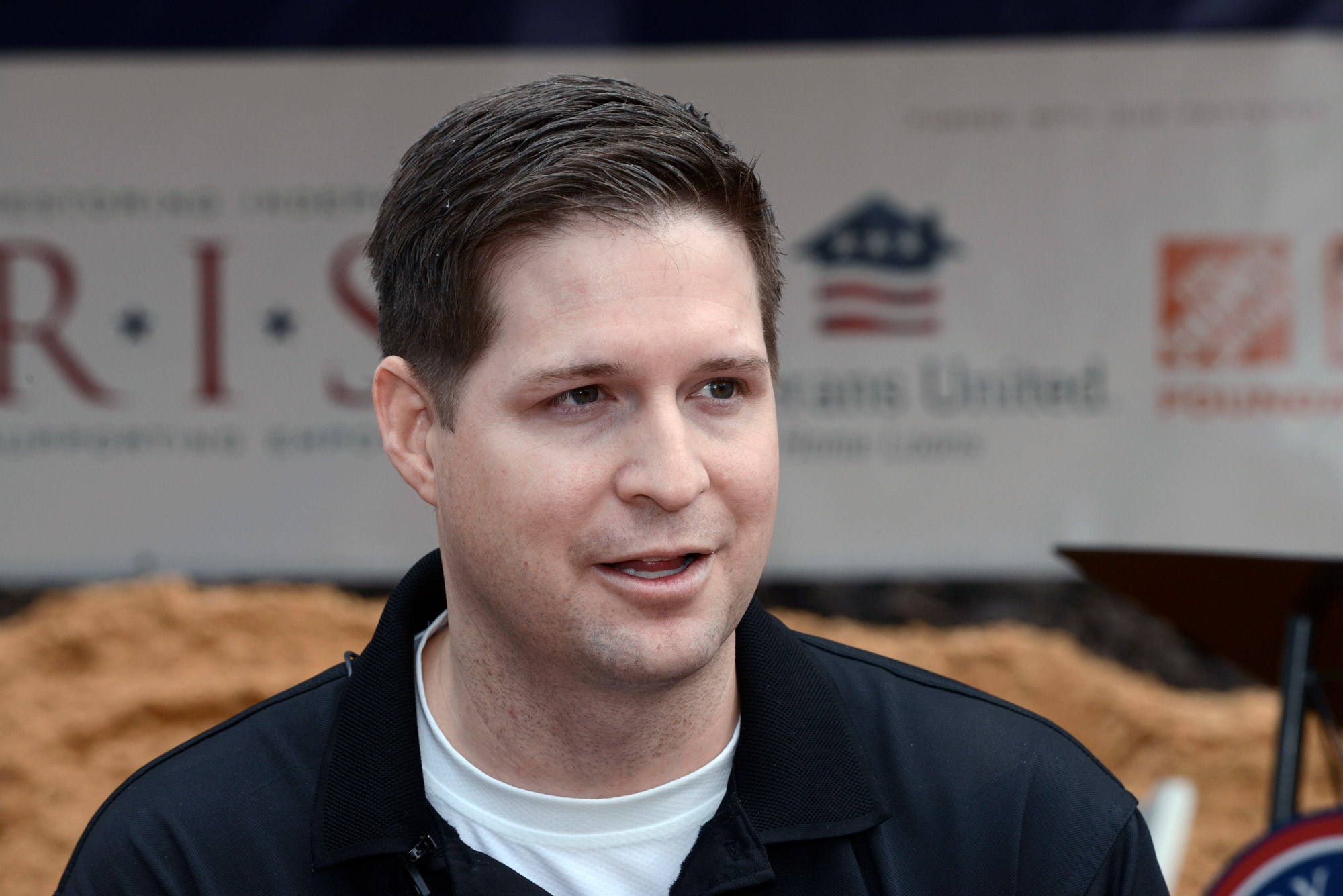 Retired U.S. Air Force Sr. Airman Brian Kolfage speaks with the media during a groundbreaking ceremony in Sandestin, Florida, on January 14, 2016.