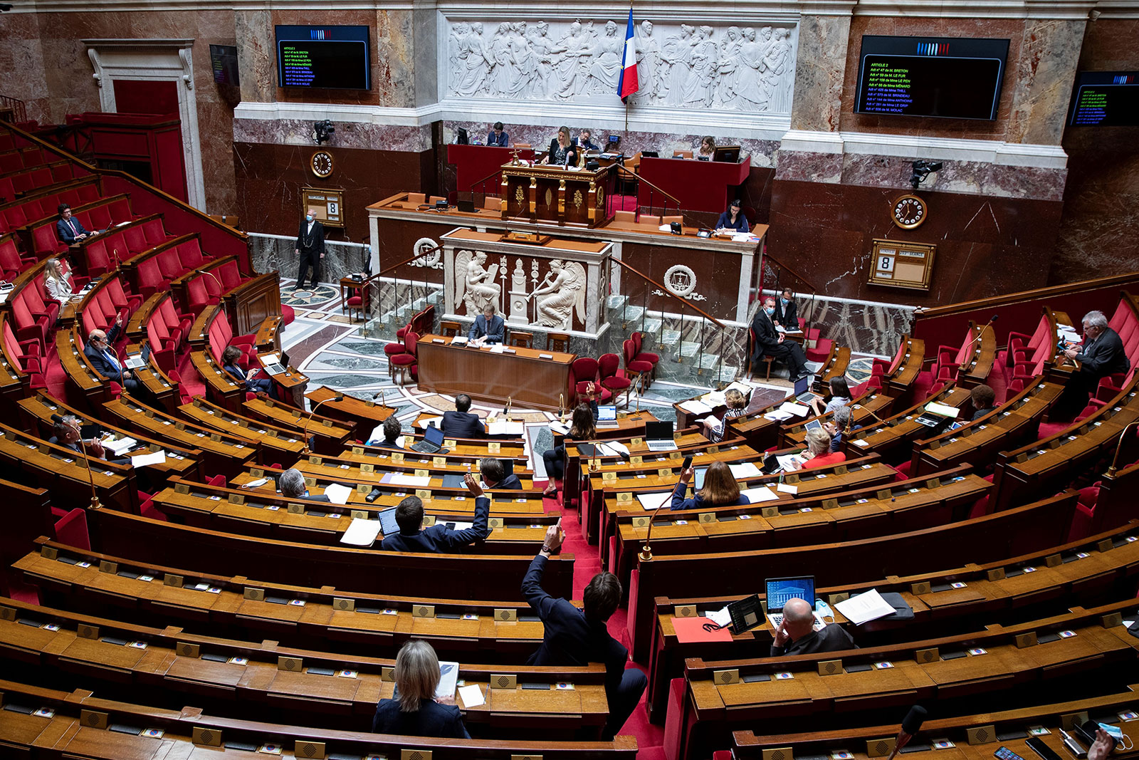 French MPs vote on an amendment during a debate on the extension of the nationwide state of emergency at the National Assembly in Paris on May 8.