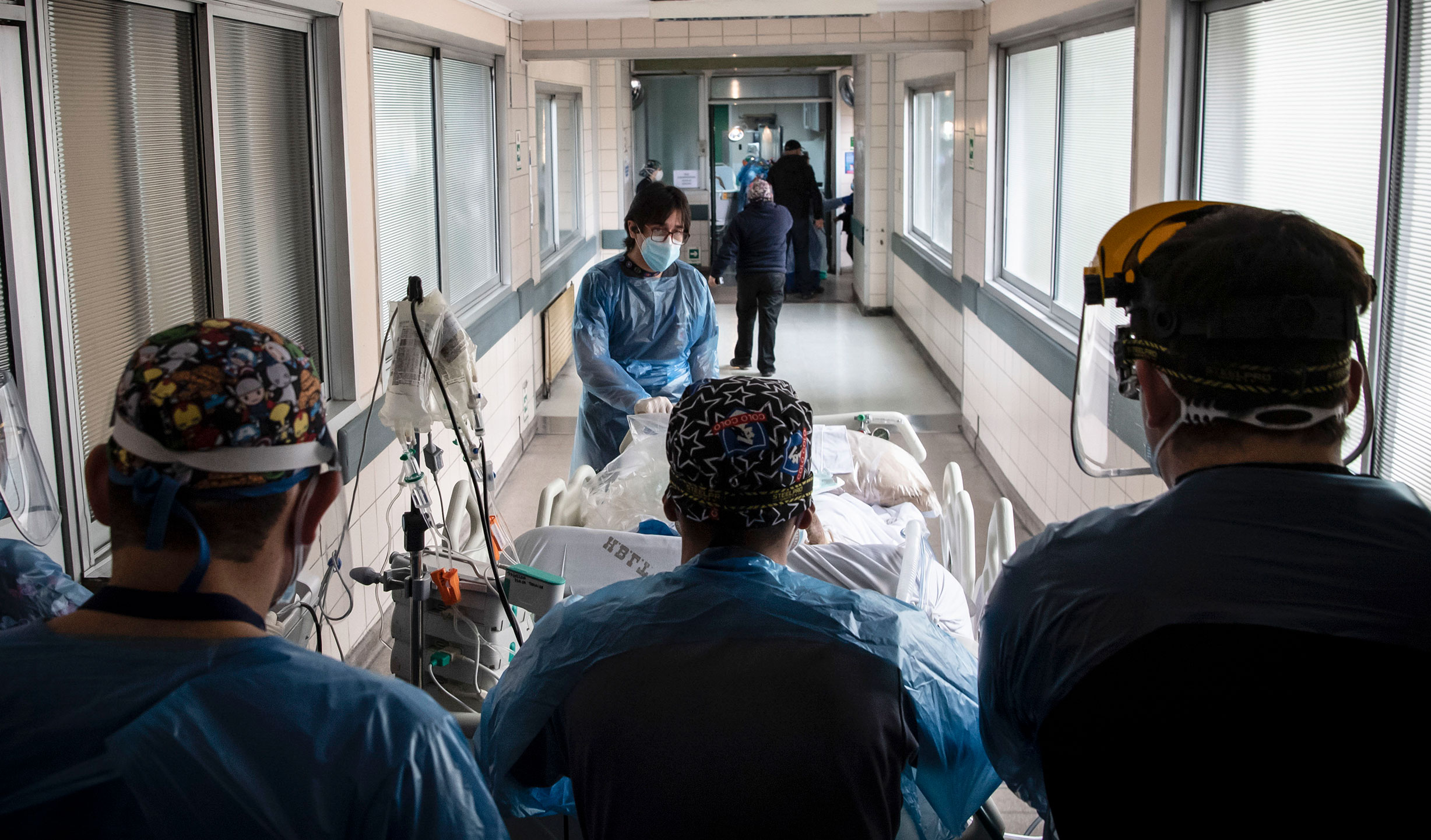 Nurses transfer a coronavirus patient to the Critical Patients Unit, at Barros Luco Hospital on June 24 in Santiago, Chile. Martin