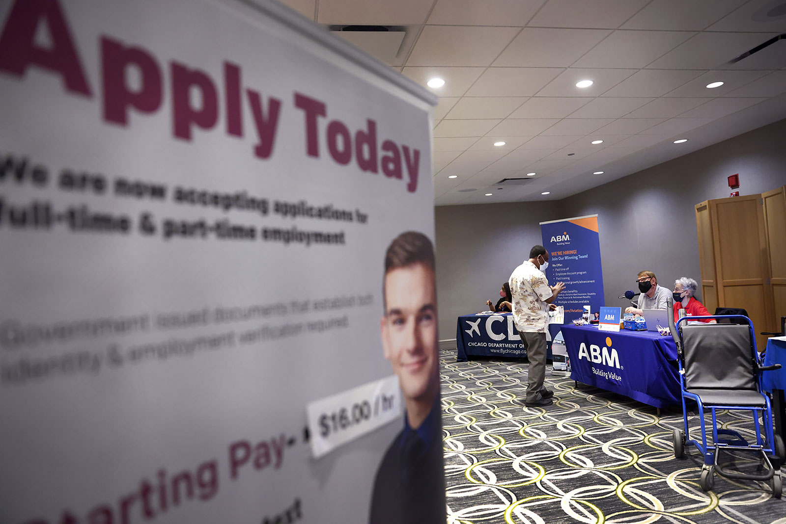 Recruiters meet with candidates at a job fair at O'Hare International Airport in Chicago on May 19.