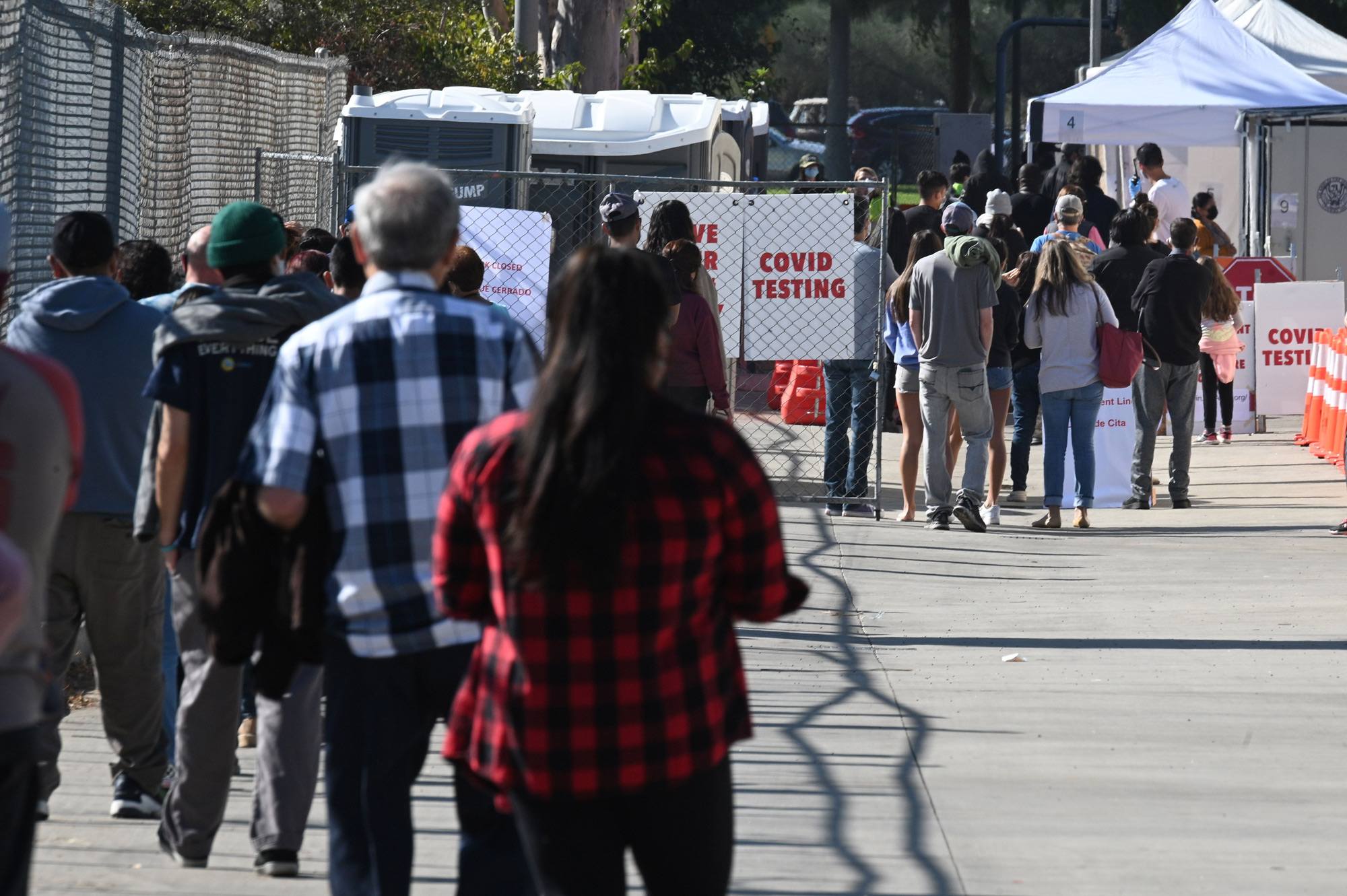 People wait in lines for coronavius tests at a walk-up Covid-19 testing site on November 24 in San Fernando, California.