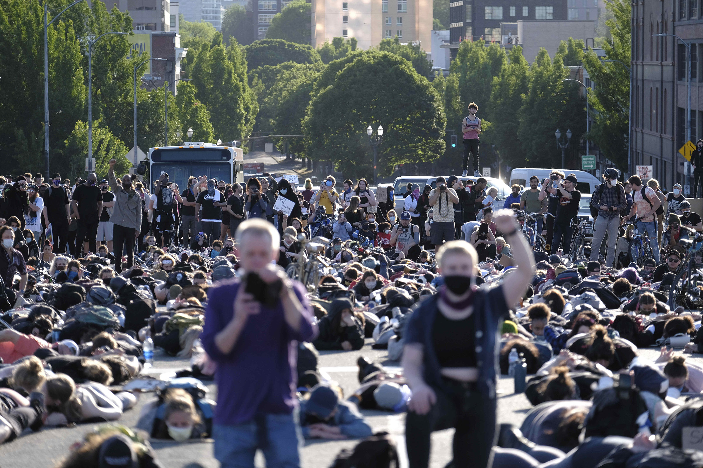 Protesters on the Burnside bridge observe a moment of silence on another day of protests over the death of George Floyd in Portland, Oregon, on June 1.