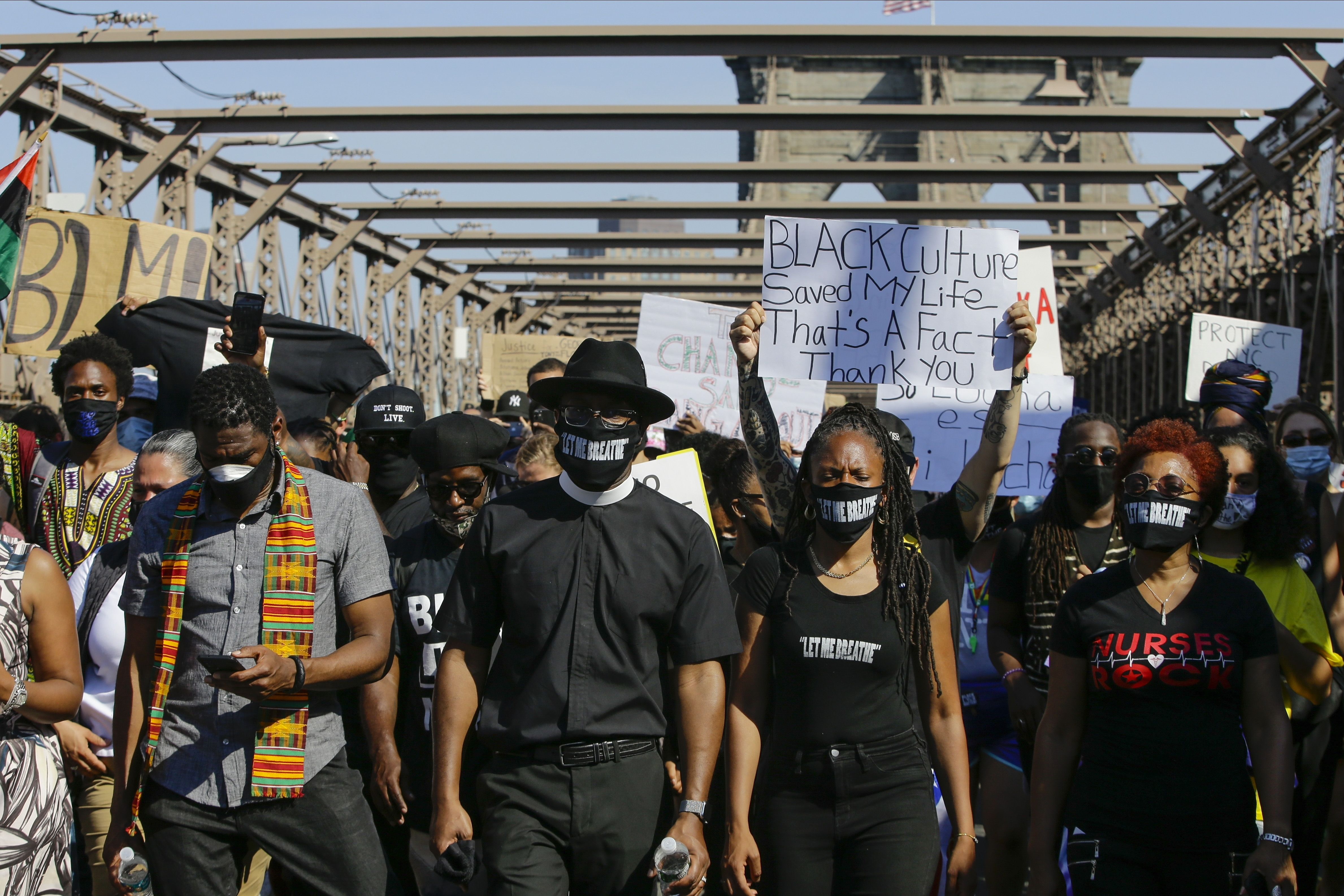 Protesters march across the Brooklyn Bridge as part of a solidarity rally June 9, calling for justice over the death of George Floyd, and to highlight police brutality nationwide.