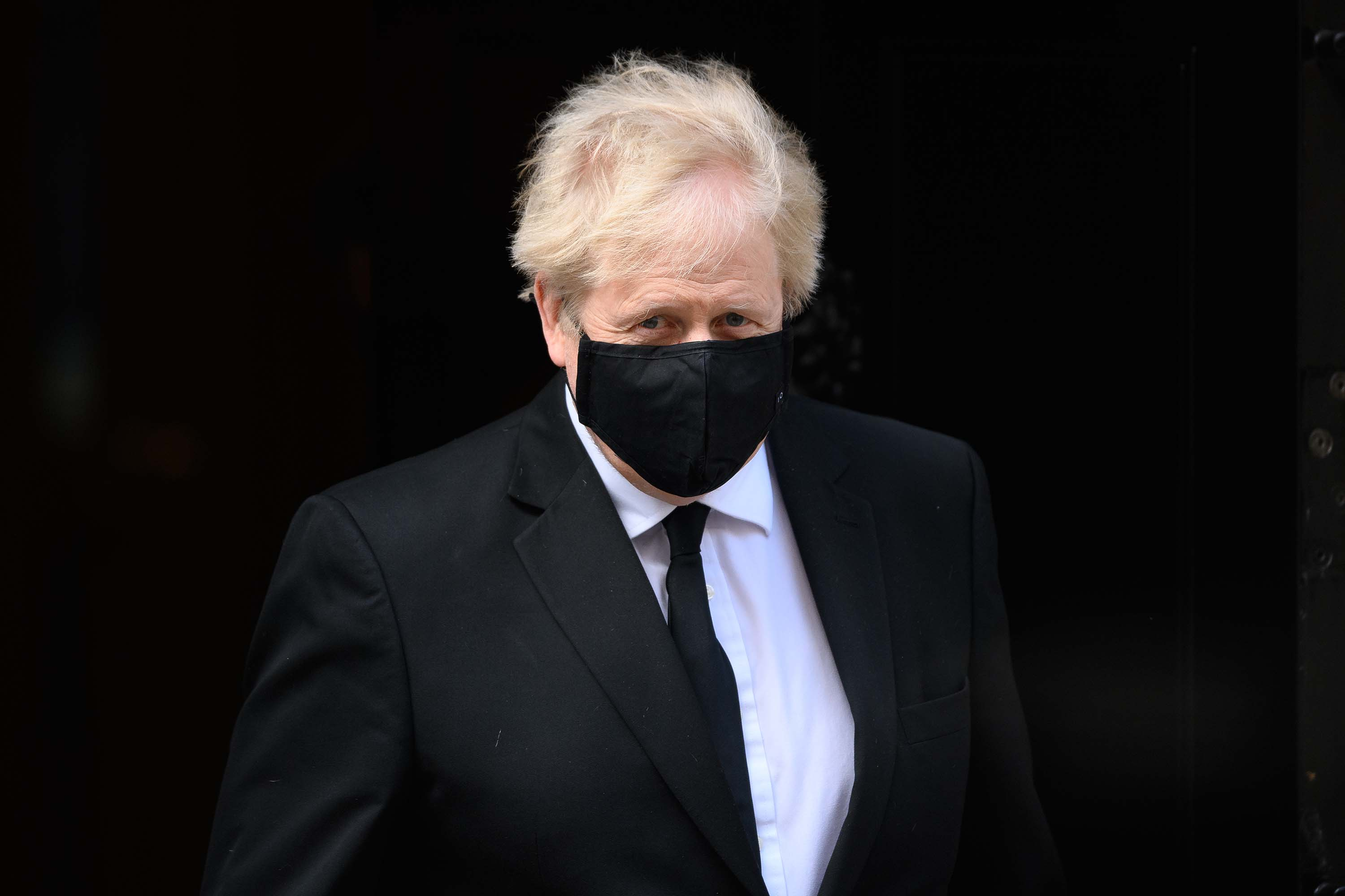 British Prime Minister Boris Johnson is pictured leaving 10 Downing Street in London, ahead of a tribute session in the House of Commons for Prince Philip, on April 12.