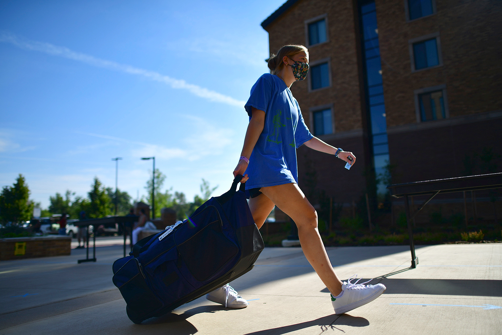 In this file photo, an incoming freshmanmoves into a campus dorm at University of Colorado Boulder on August 18, 2020 in Boulder, Colorado.