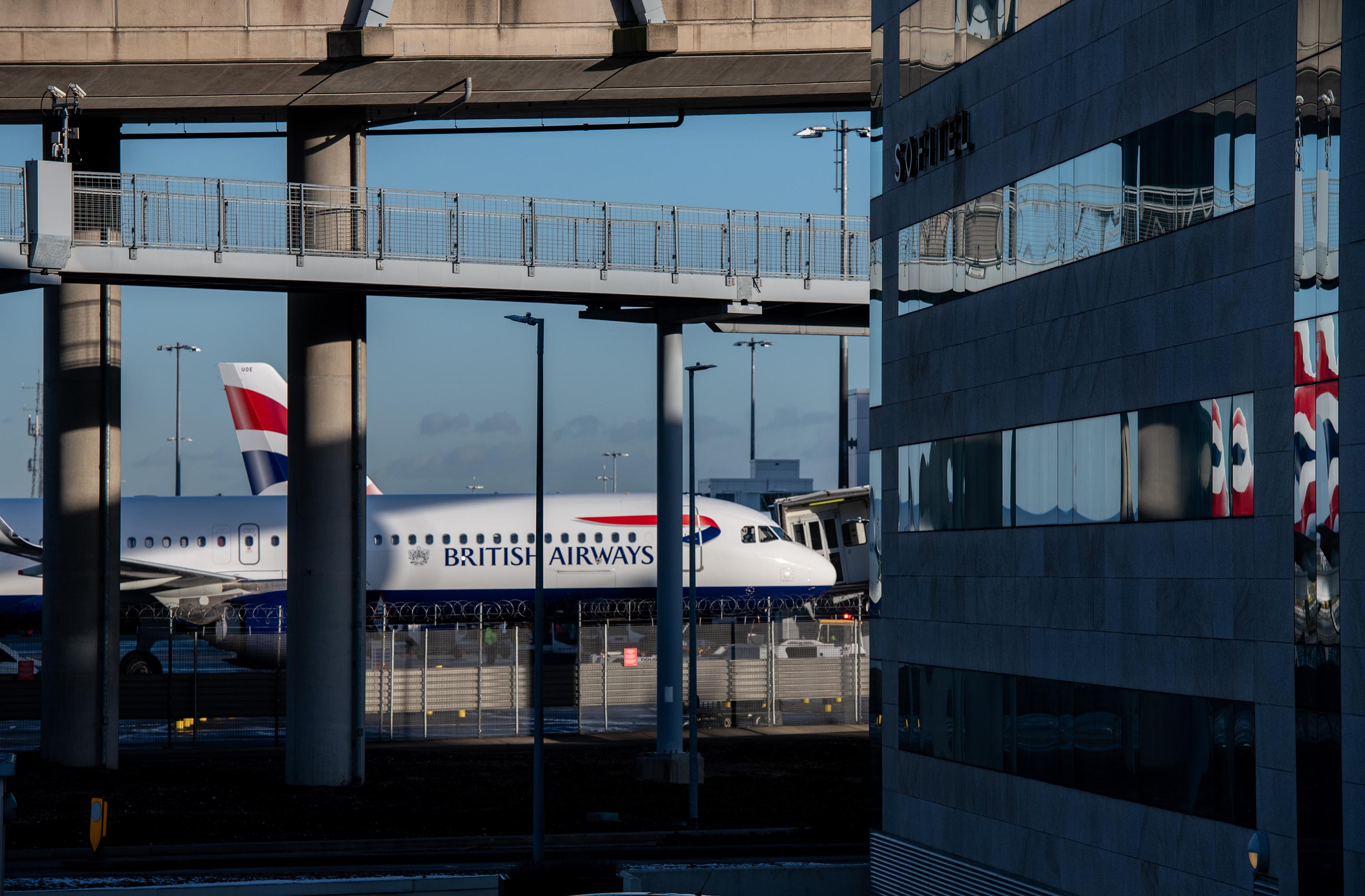 British Airways airplanes are seen behind a Sofitel hotel at Heathrow Airport on January 25, in London, England.
