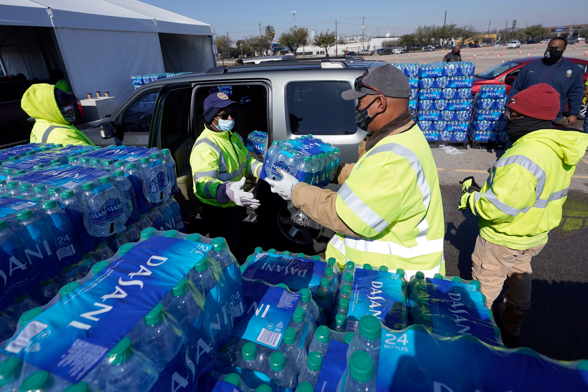 Water is loaded into a vehicle at a water distribution site on February 19 in Houston, Texas.