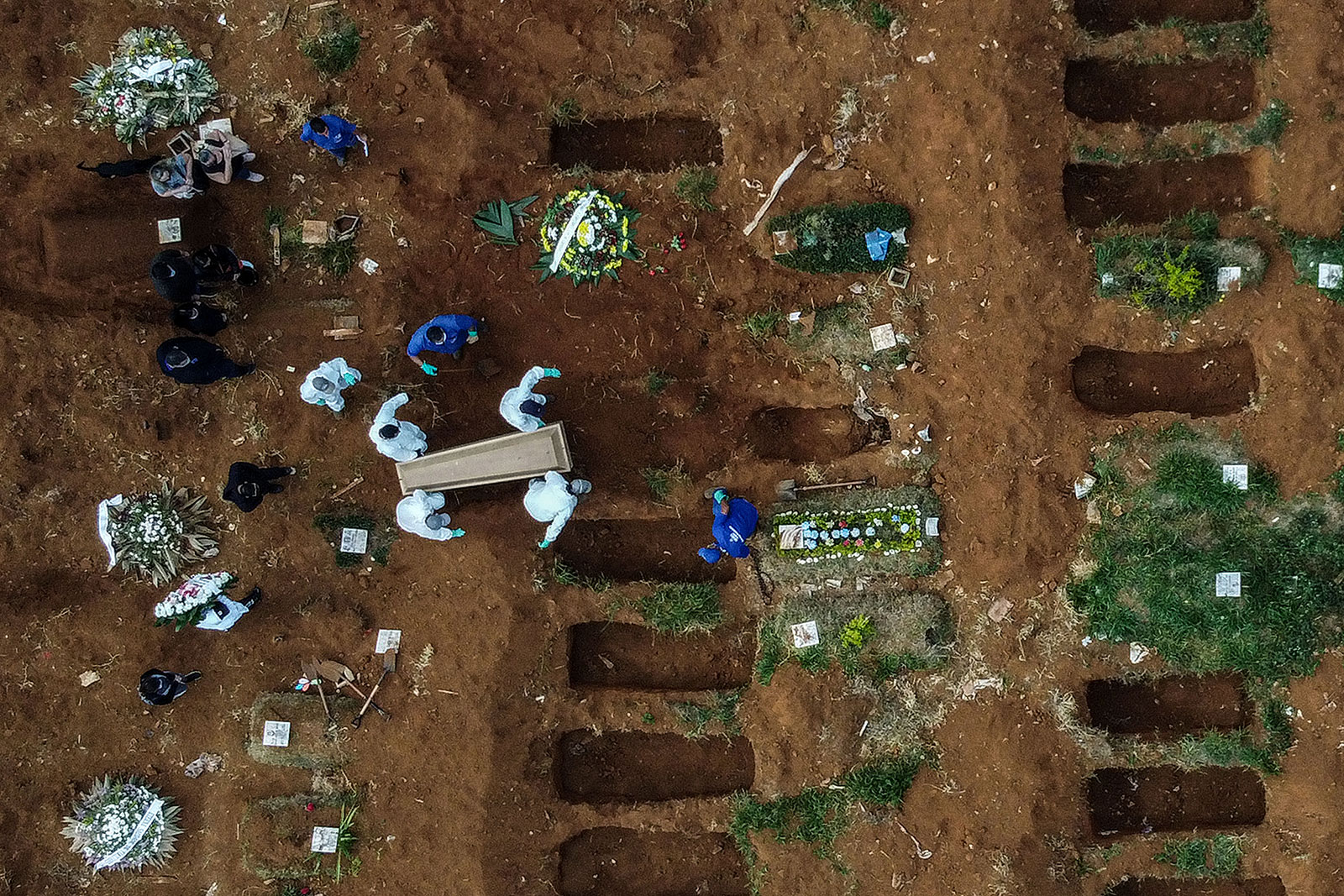 This aerial photo shows an alleged coronavirus victim being buried at the Vila Formosa Cemetery, on the outskirts of Sao Paulo, Brazil, on May 22.