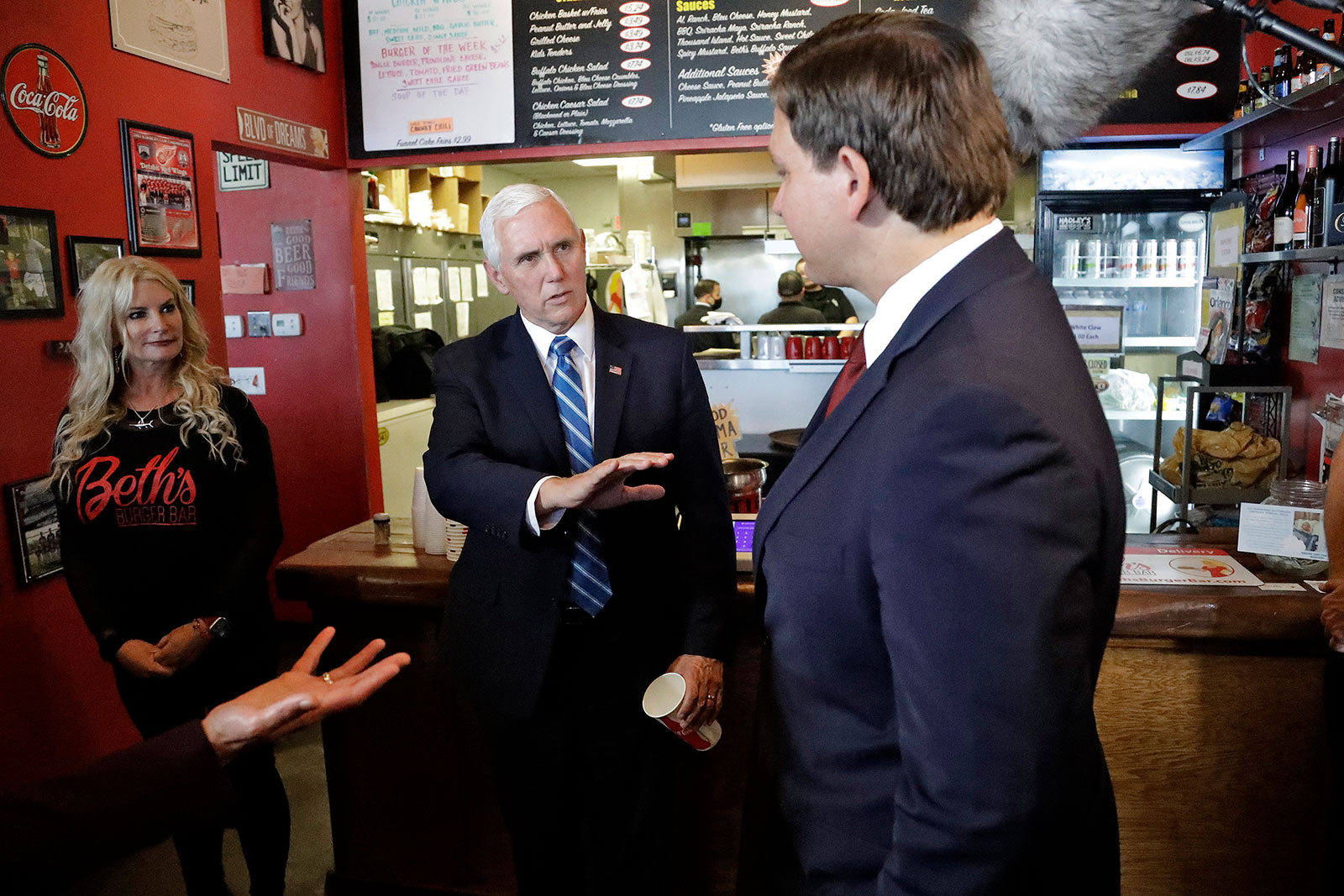 Vice President Mike Pence speaks toFlorida Gov. Ron DeSantis after ordering lunch at Beth's Burger Bar in Orlando, Florida, on Wednesday, May 20.