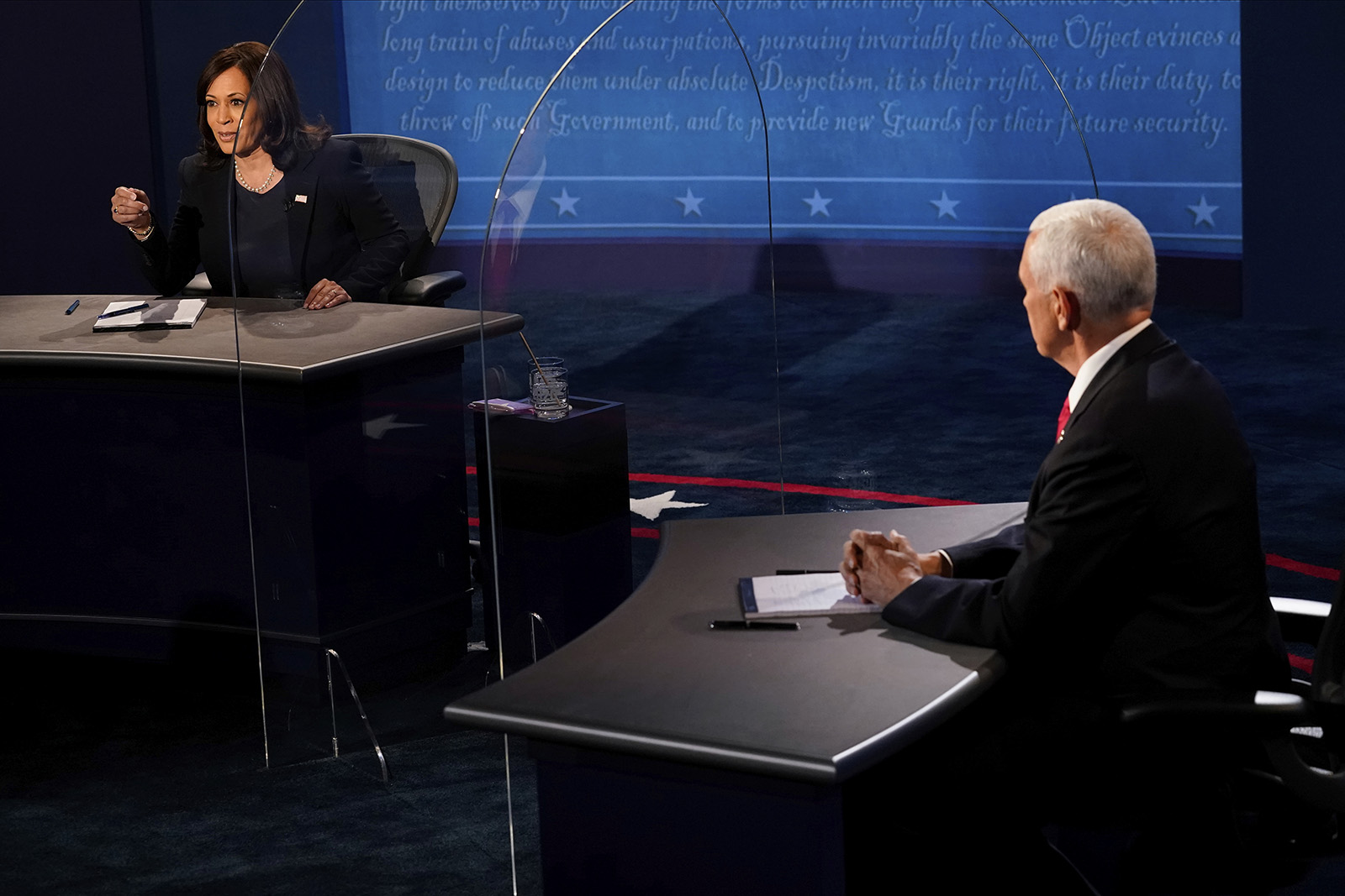 Democratic vice presidential candidate Sen. Kamala Harris, D-Calif., answers a question as Vice President Mike Pence listens during the vice presidential debate on Wed