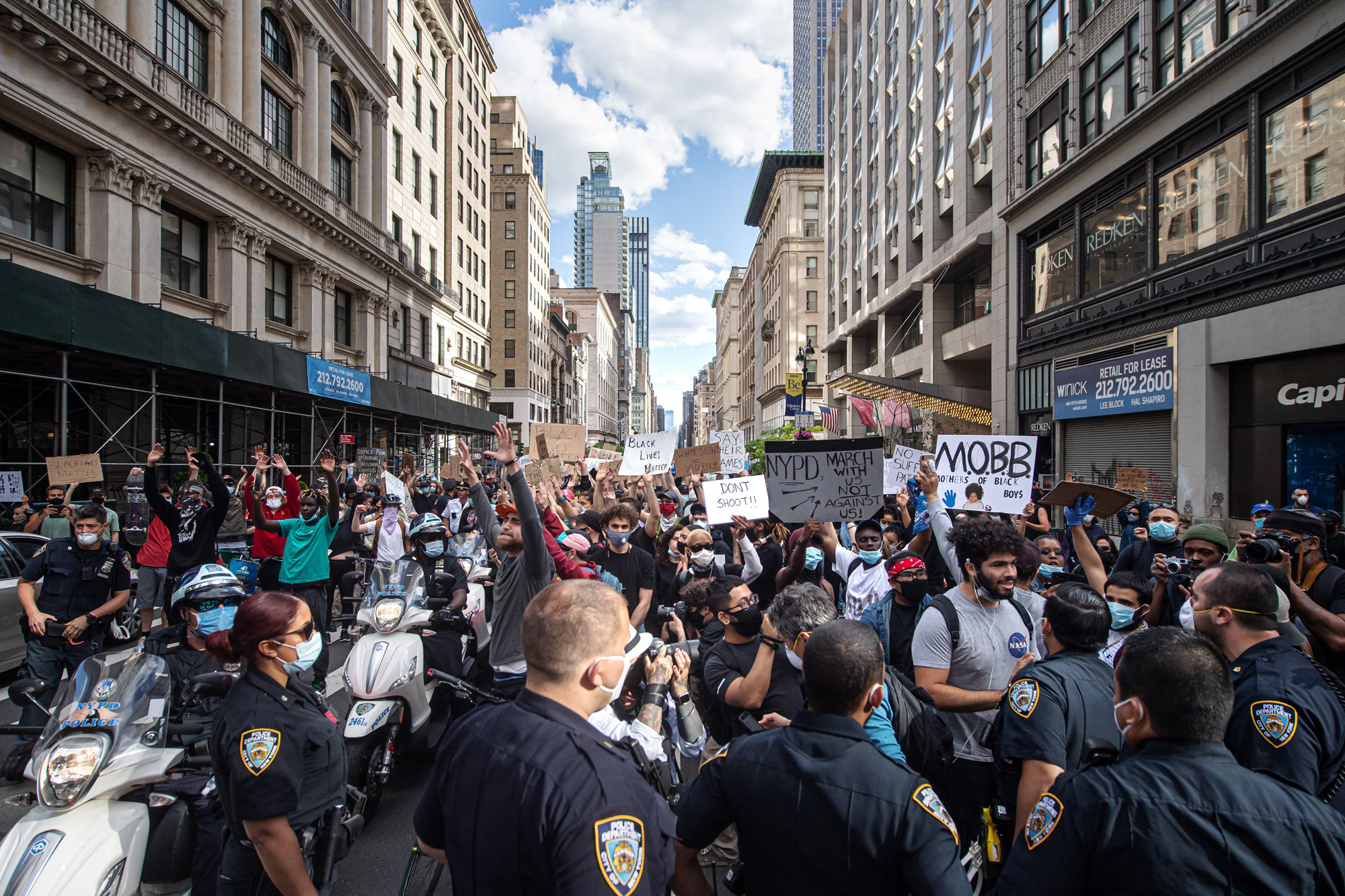 Demonstrators protest on May 31 in the Manhattan borough of New York City.