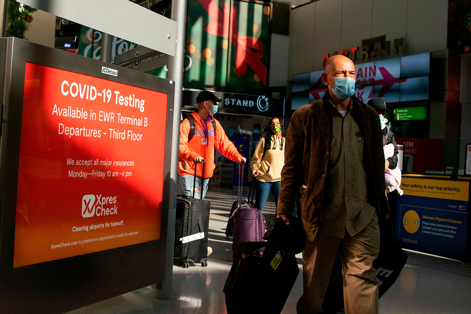 Travelers walk through Newark International Airport in Newark, New Jersey, on November 21.