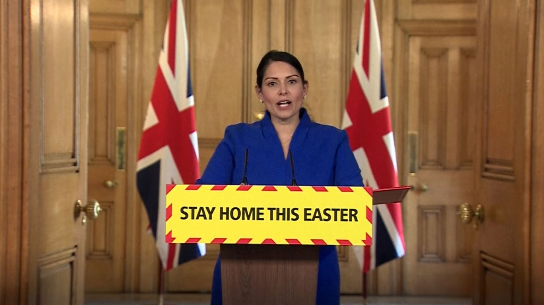 UK Home Secretary Priti Patel speaks from Downing Street in London on April 11.
