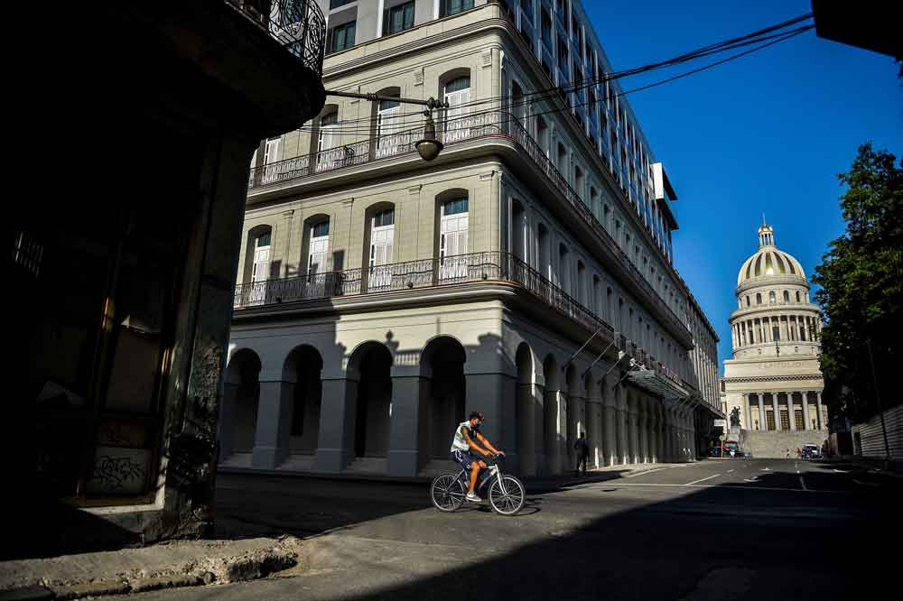 A man rides his bicycle along an empty street in Havana on May 19.