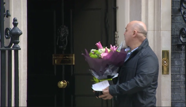 A delivery man brings flowers to the door of the Prime Minister's residence on Friday.