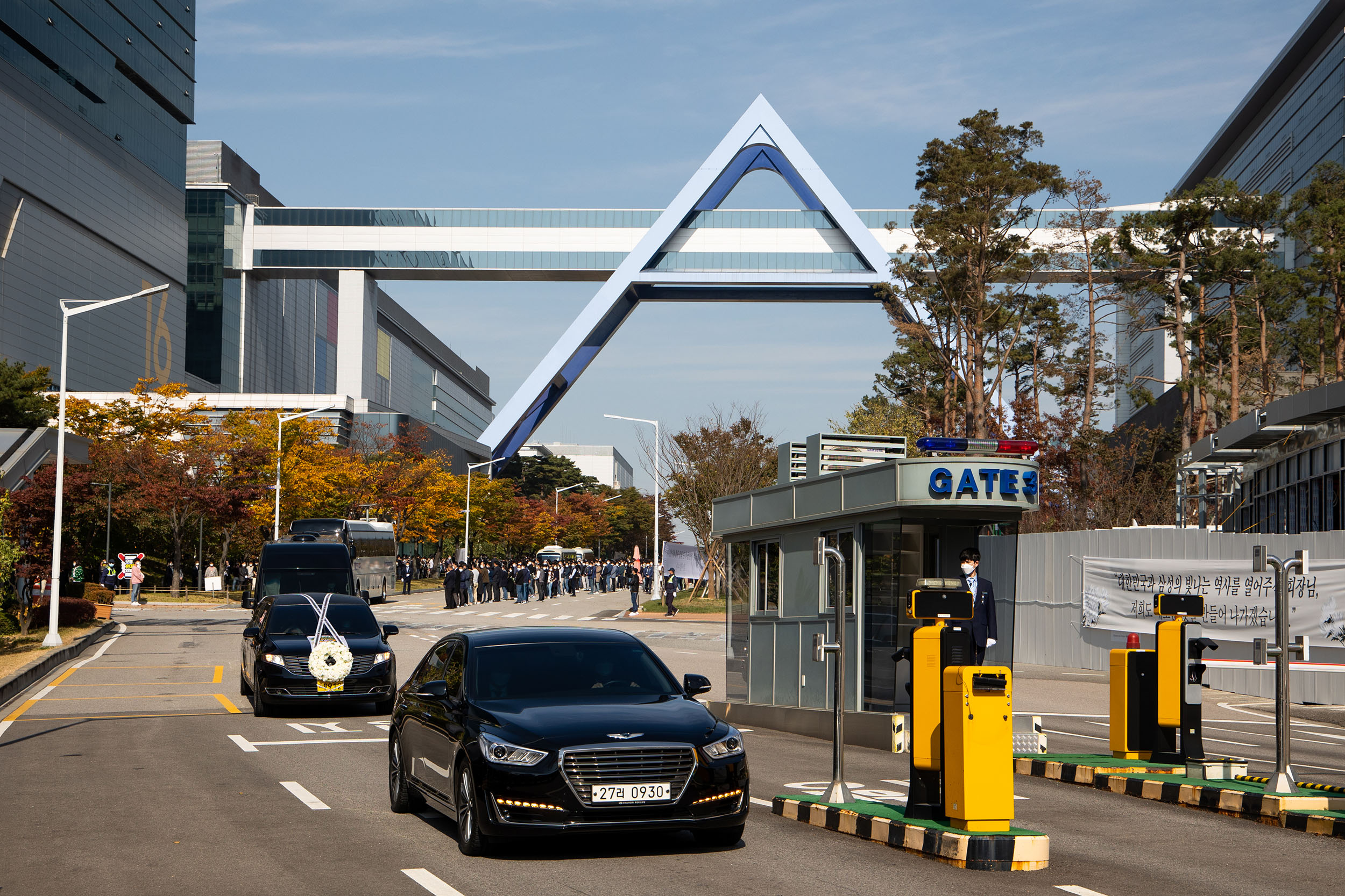 A hearse carrying the casket of Samsung Electronics Co. Chairman Lee Kun-hee, left, leaves the company's semiconductor plant in South Korea, on Wednesday, October 28.