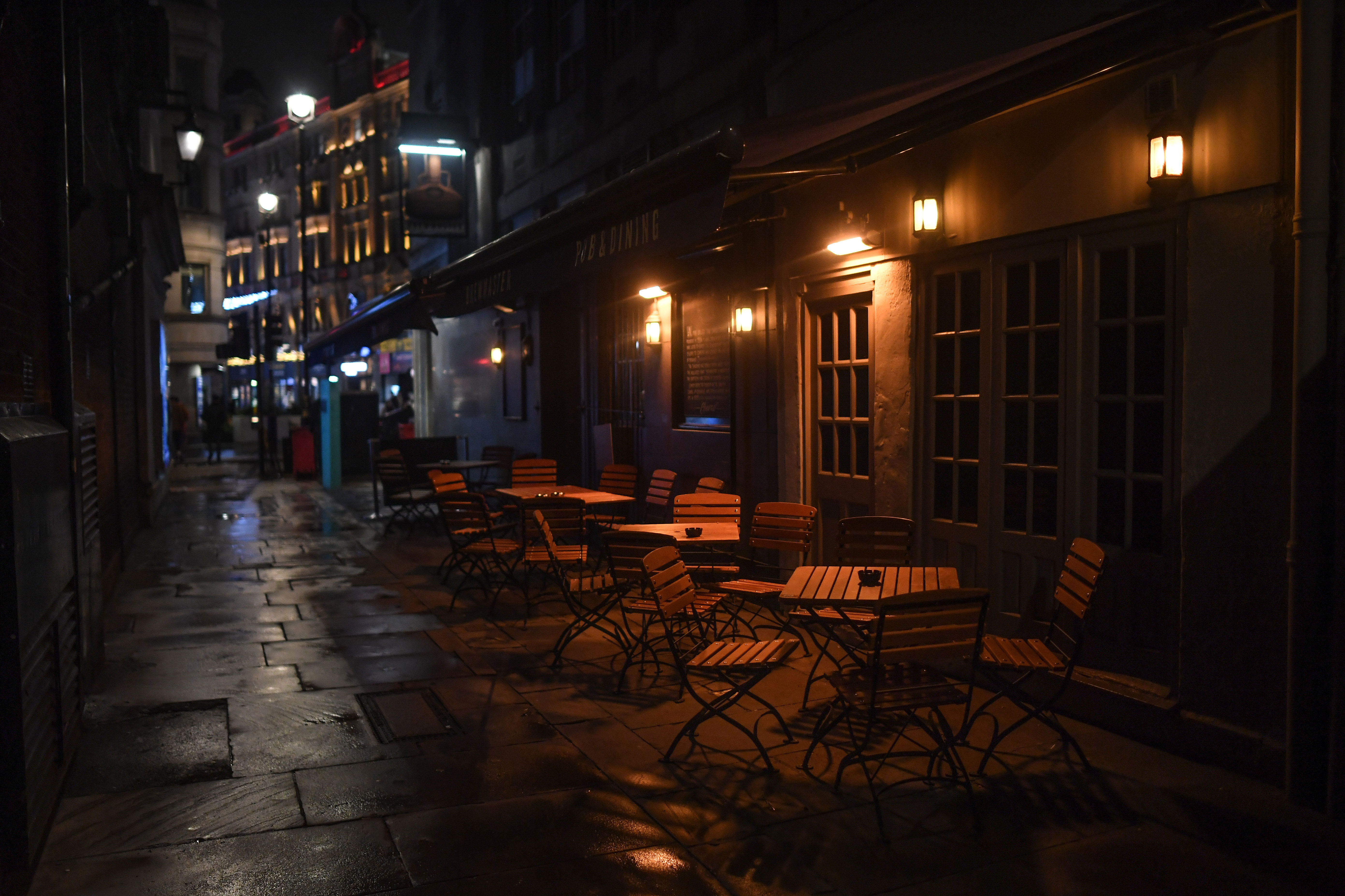 Empty tables are seen outside a restaurant on December 2 in London.