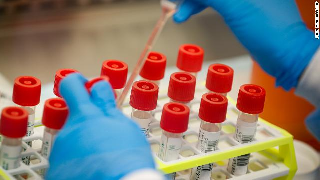 A lab technician prepares coronavirus patient samples for semi-automatic testing at Northwell Health Labs, Wednesday, March 11, in Lake Success, New York.