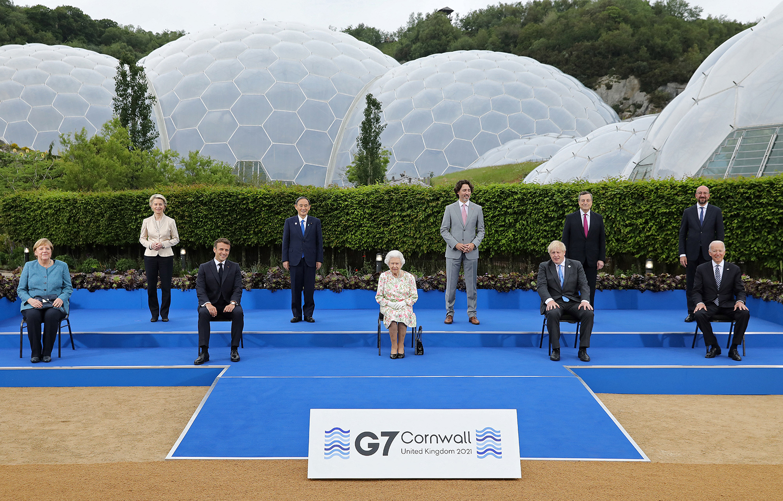 Britain's Queen Elizabeth II, center, poses for a photograph with, from left, Germany's Chancellor Angela Merkel, President of the European Commission Ursula von der Leyen, France's President Emmanuel Macron, Japan's Prime Minister Yoshihide Suga, Canada's Prime Minister Justin Trudeau, Britain's Prime Minister Boris Johnson , Italy's Prime minister Mario Draghi, President of the European Council Charles Michel and US President Joe Biden, during an evening reception at The Eden Project in England on June 11.